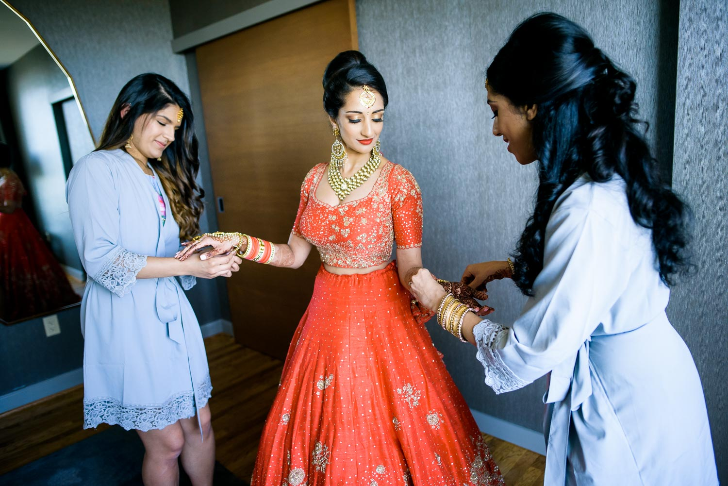 Bride getting ready with bridesmaids during a Renaissance Schaumburg Convention Center Indian wedding.