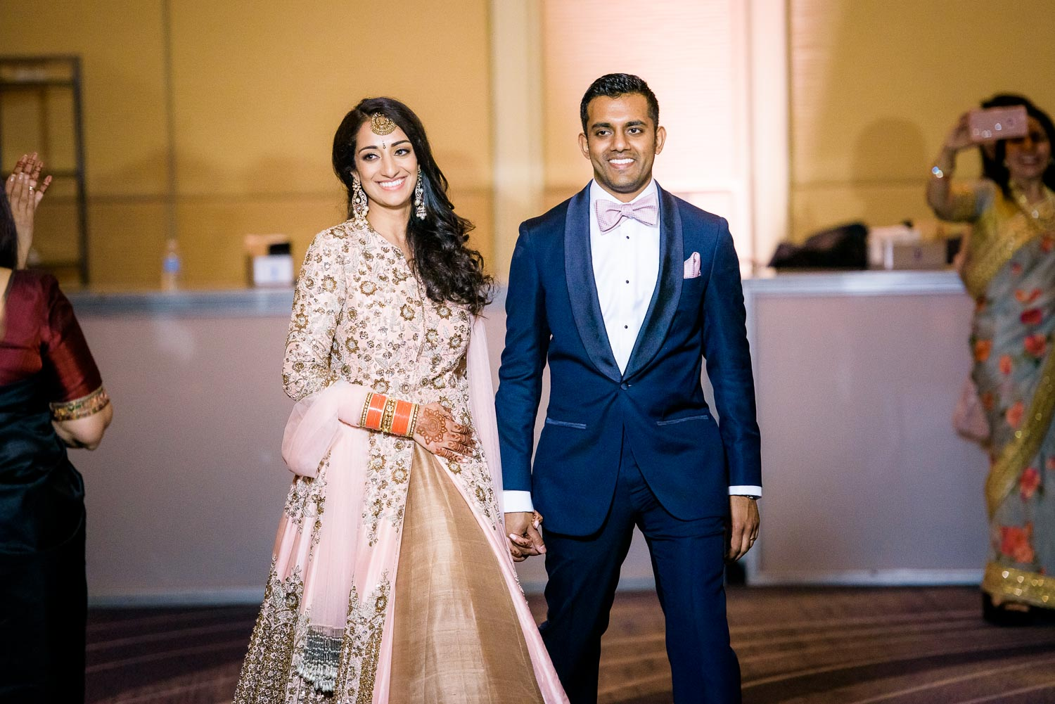 Bride and groom introductions during a Renaissance Schaumburg Convention Center Indian wedding reception.