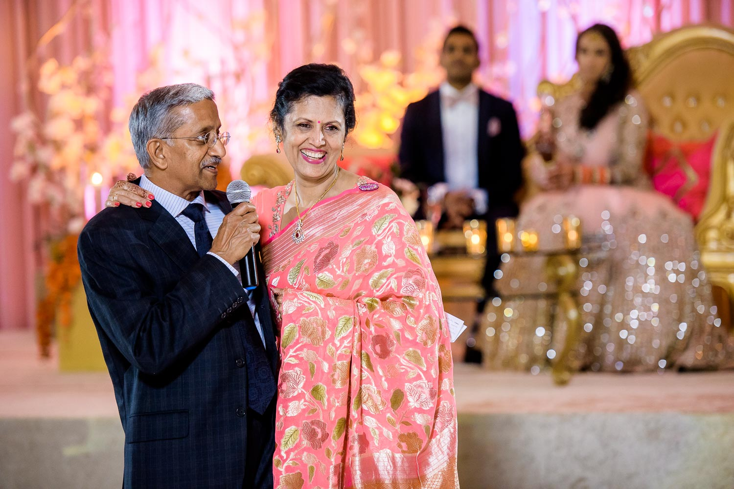 Parents of the groom toast during a Renaissance Schaumburg Convention Center Indian wedding reception.