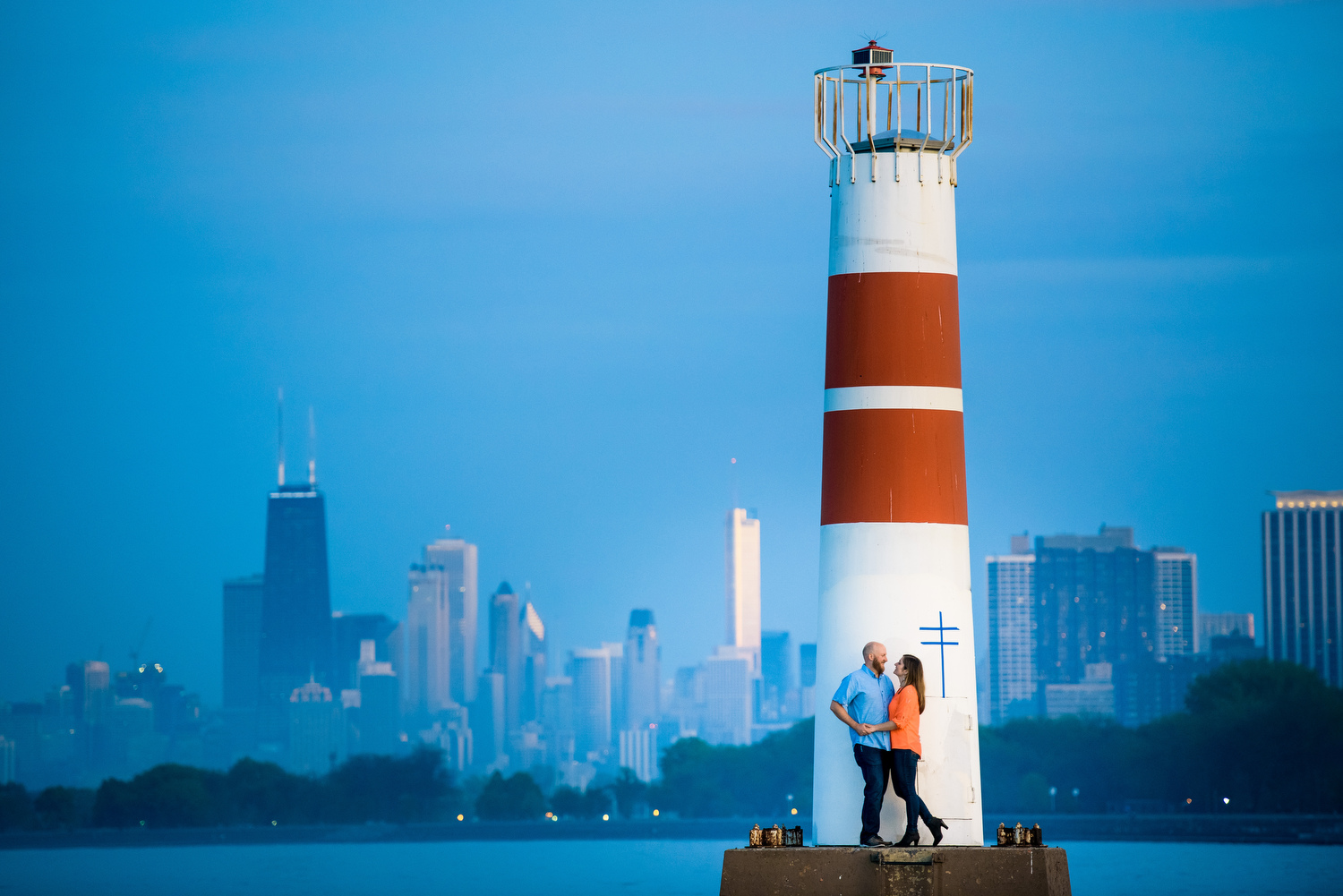 Creative engagement session photo at the Montrose Harbor lighthouse Chicago.
