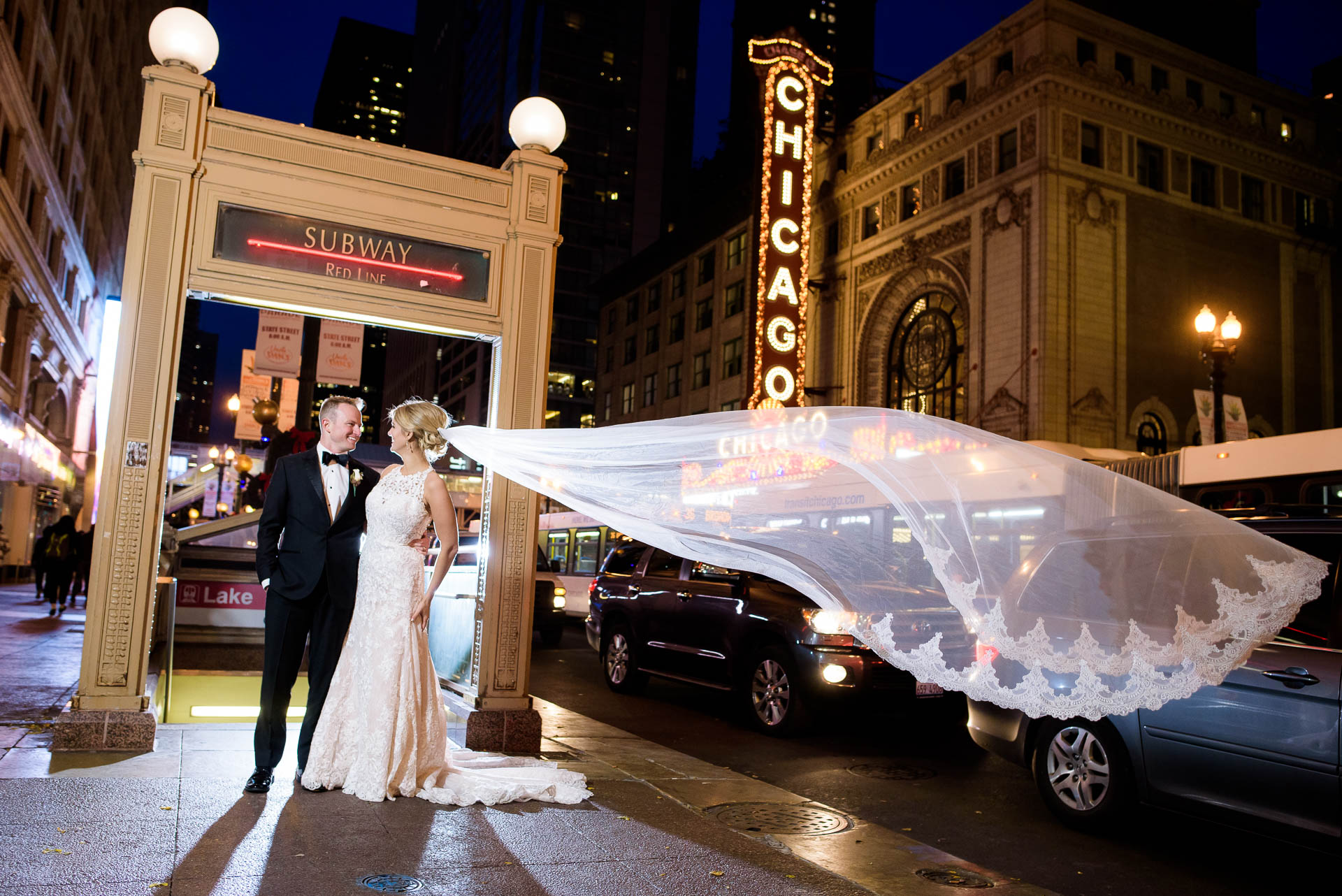 Bride and groom wedding photo outside the Chicago Theater during their Mid-America Club wedding.