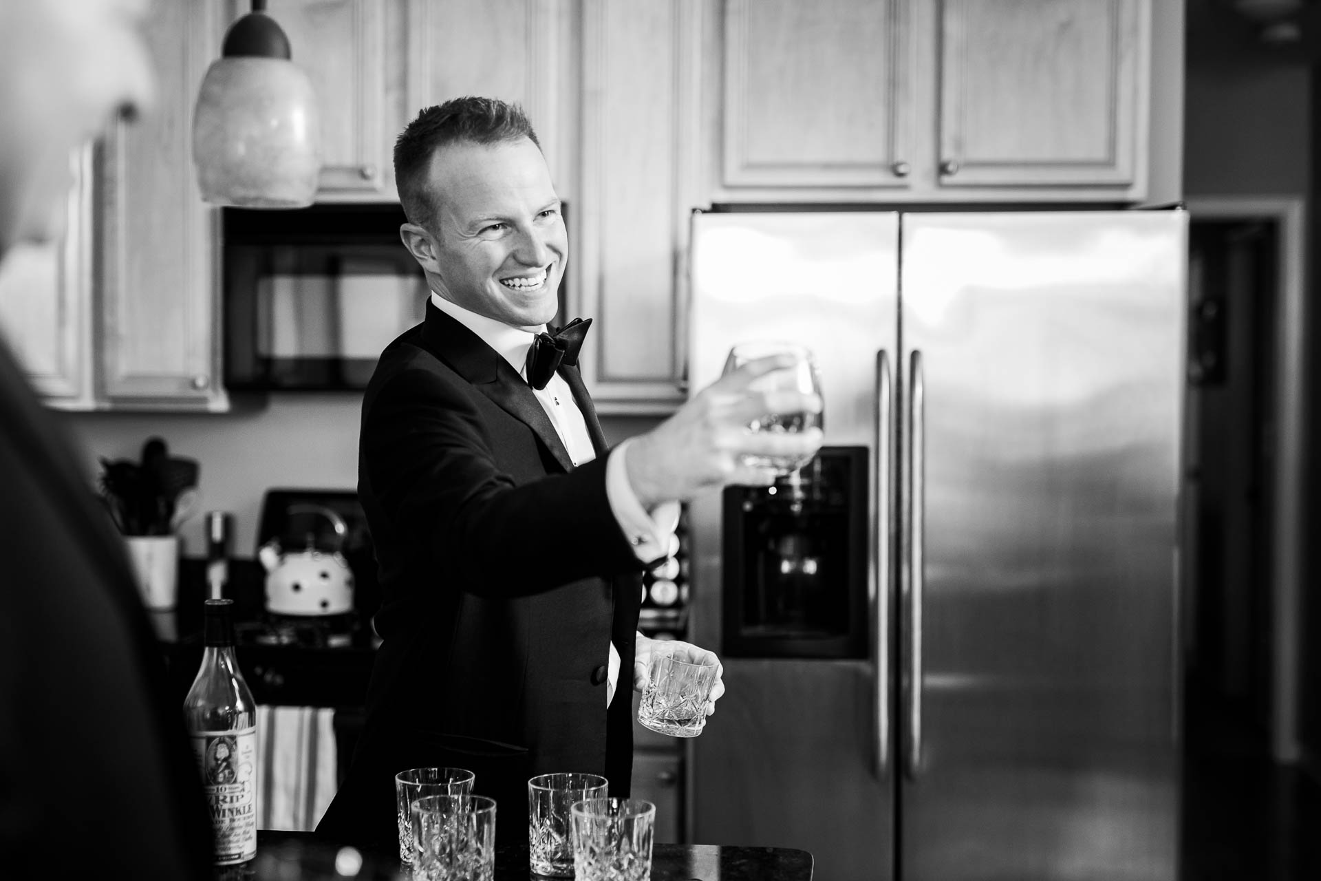 Groom gives a toast while getting ready before a Mid America Club wedding Chicago.