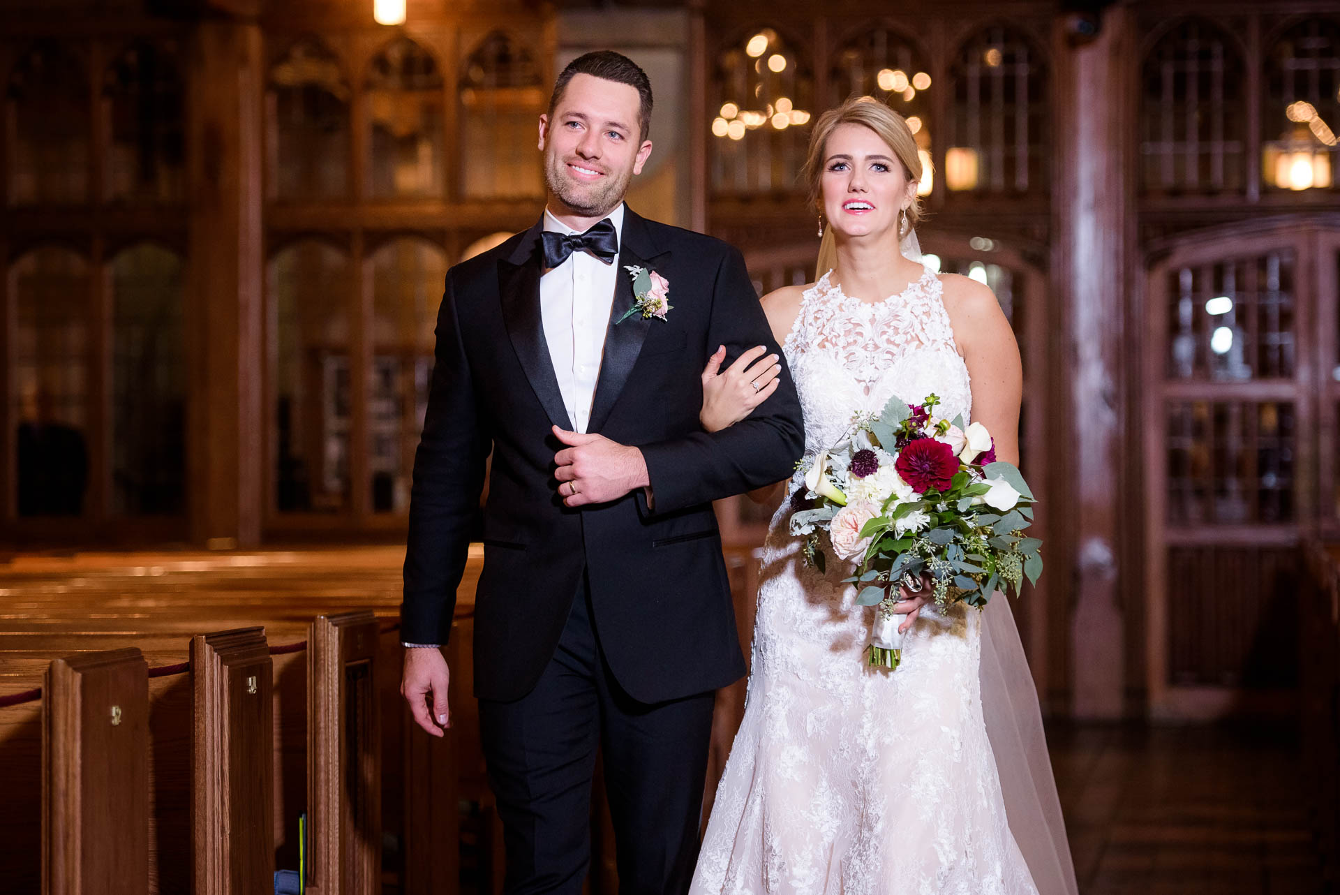 Brother and bride walk down the aisle during a wedding ceremony at Fourth Presbyterian Church in Chicago.