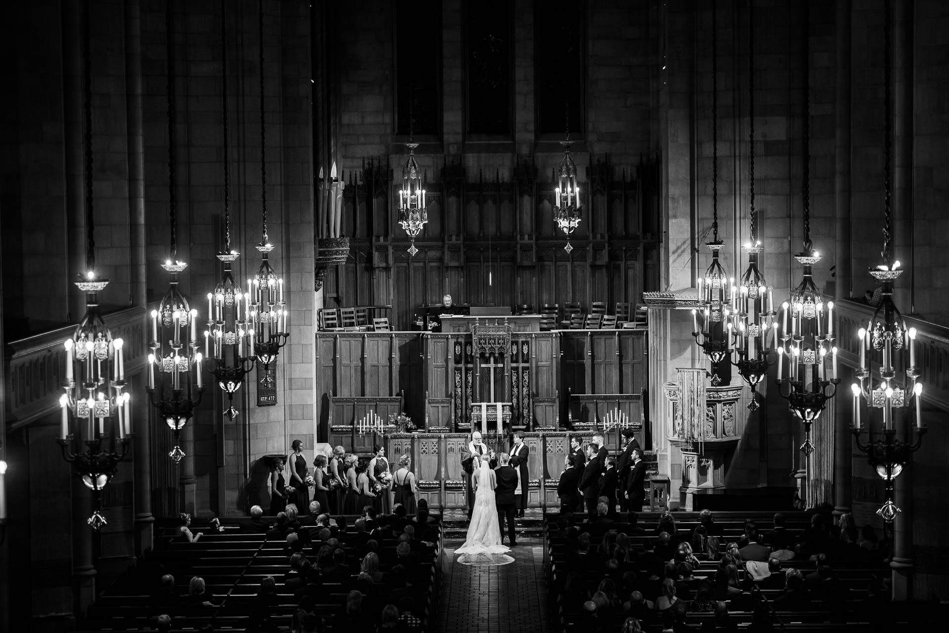 Black and white photo of a wedding ceremony at Fourth Presbyterian Church in Chicago.