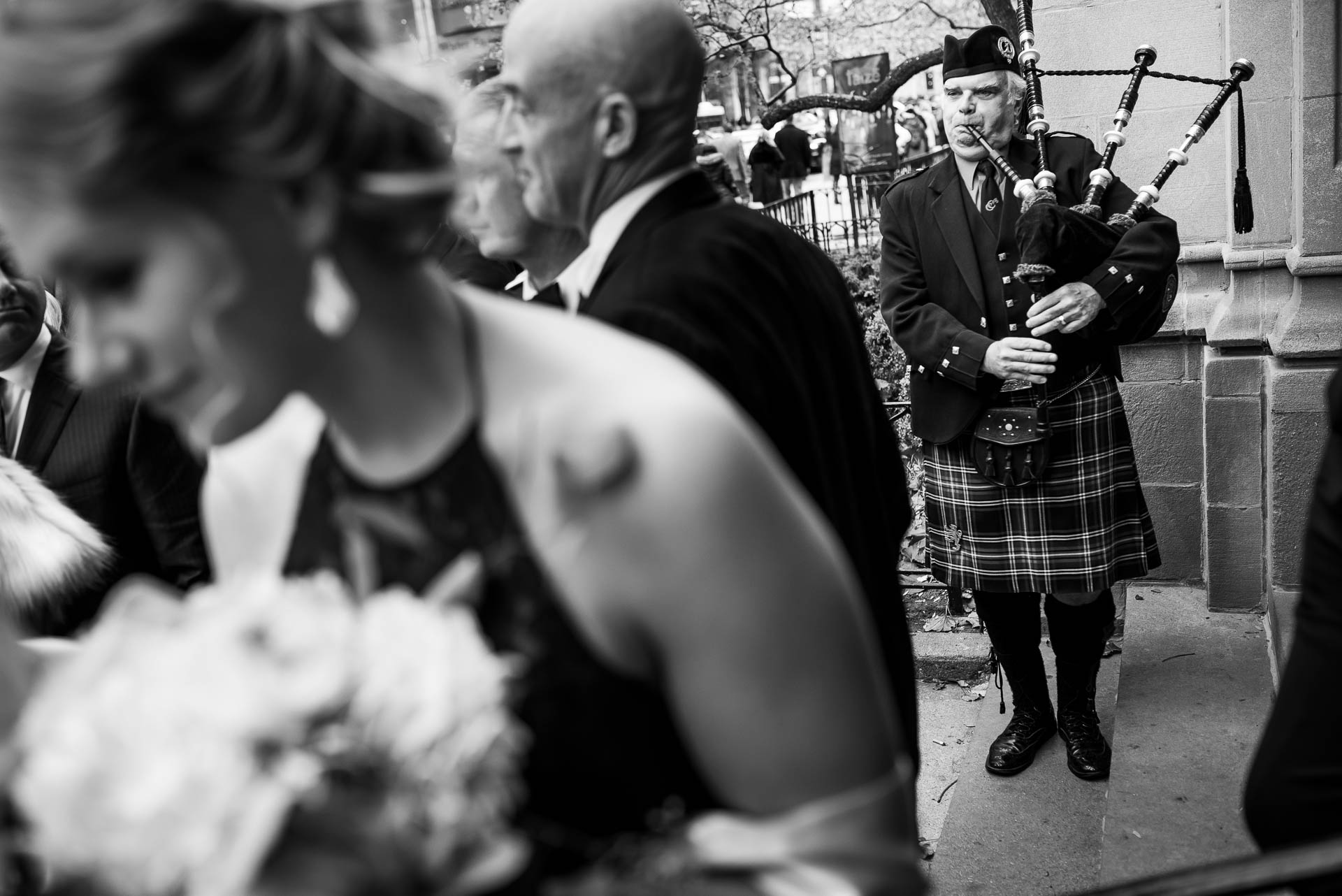 Bagpiper plays after a wedding ceremony at Fourth Presbyterian Church in Chicago.