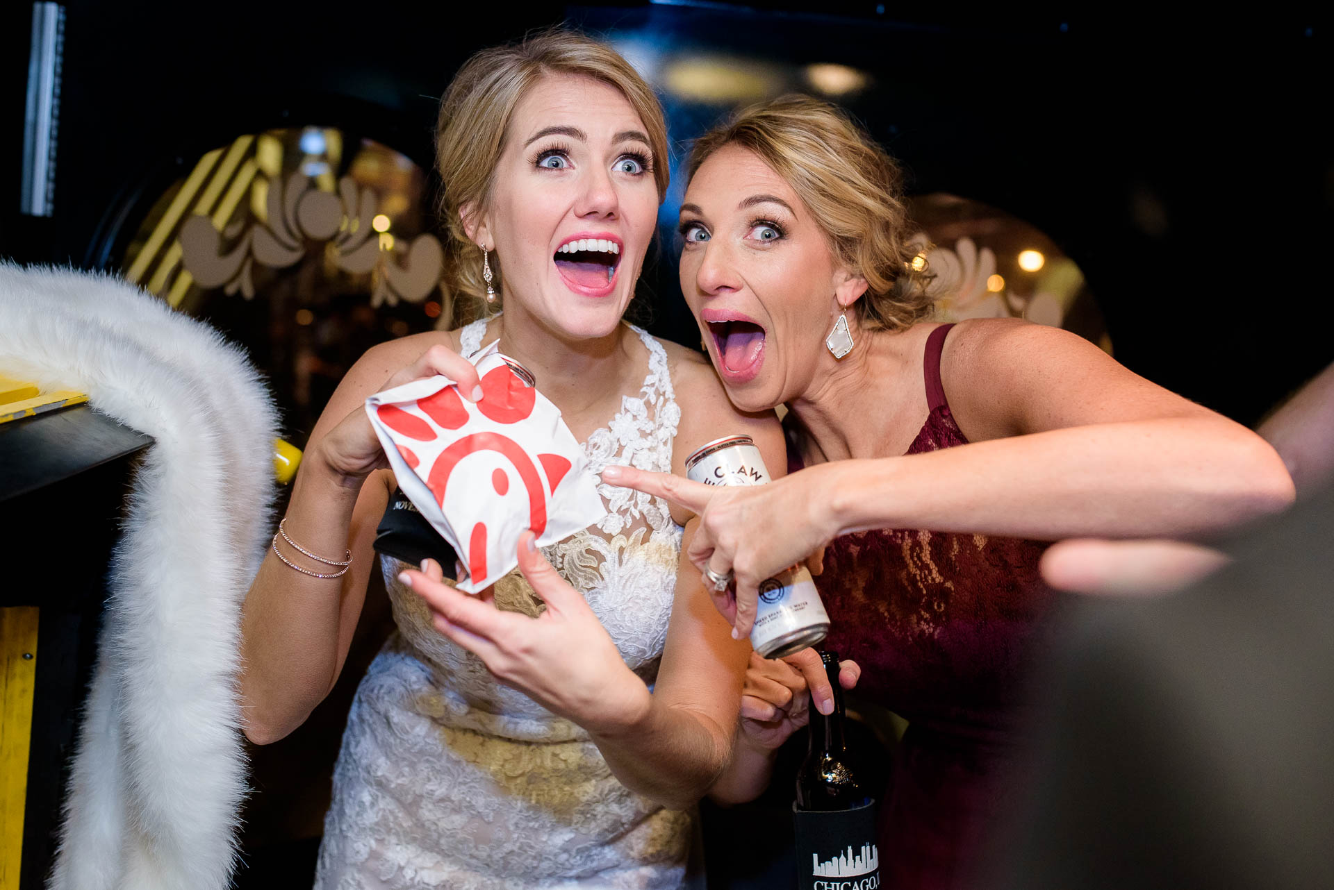Bride and maid of honor with Chic Filet during a Mid America Club wedding in Chicago.