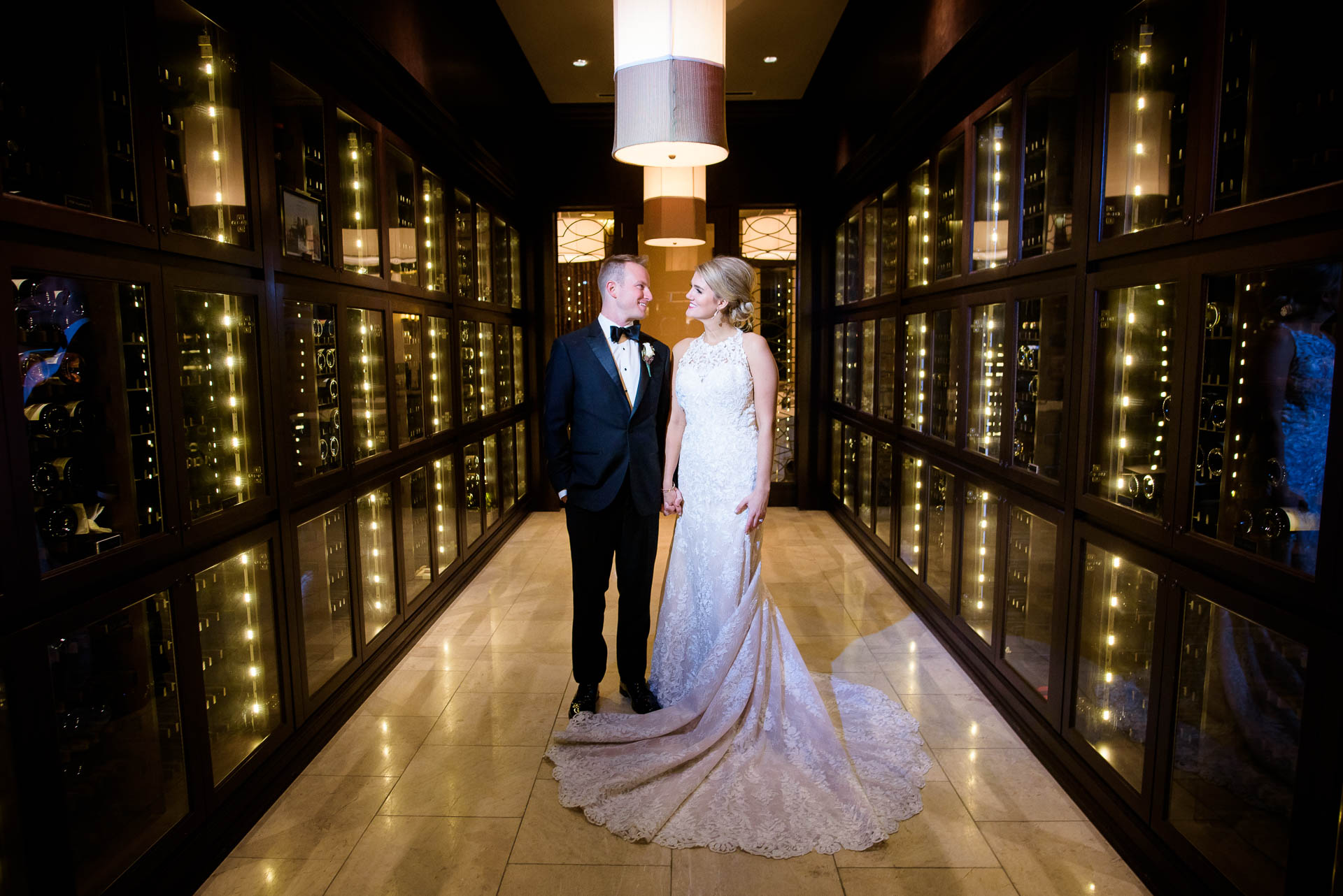 Creative wedding photo of bride and groom inside the wine cellar at the Mid America Club in Chicago.
