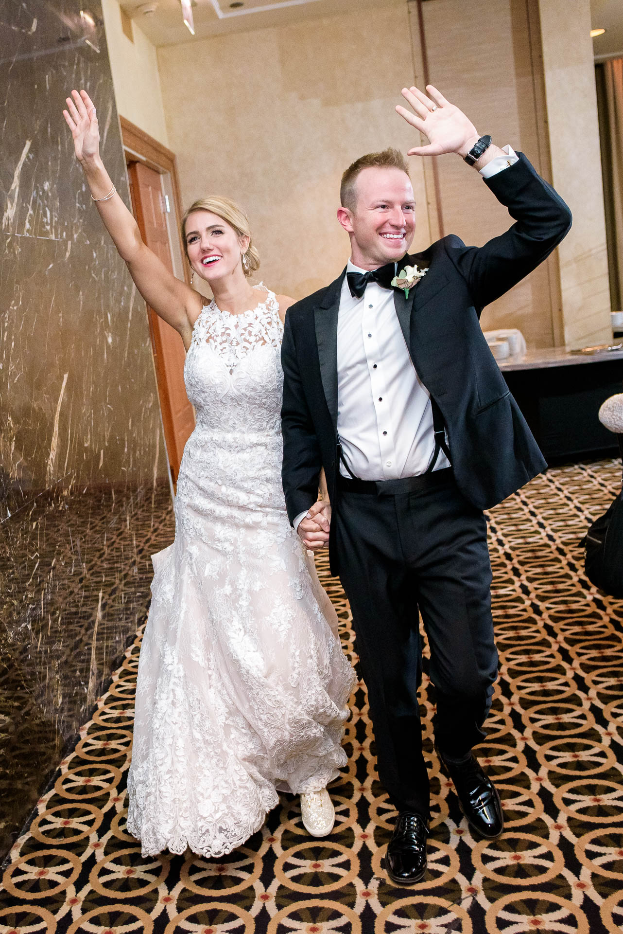 Bride and groom are introduced during their wedding reception at the Mid America Club in Chicago.