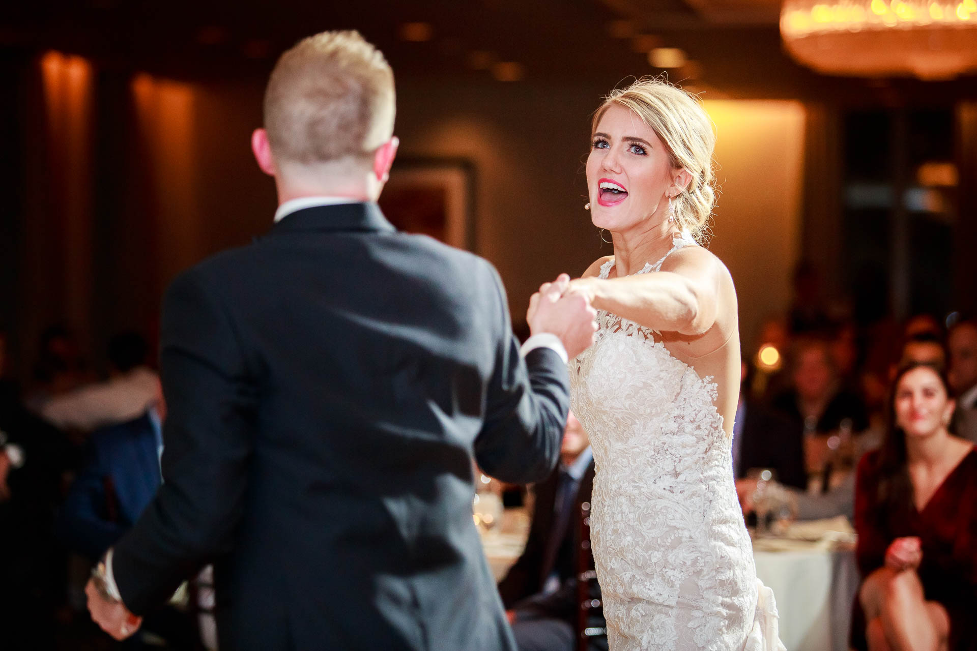 during their wedding reception at the Mid America Club in Chicago.