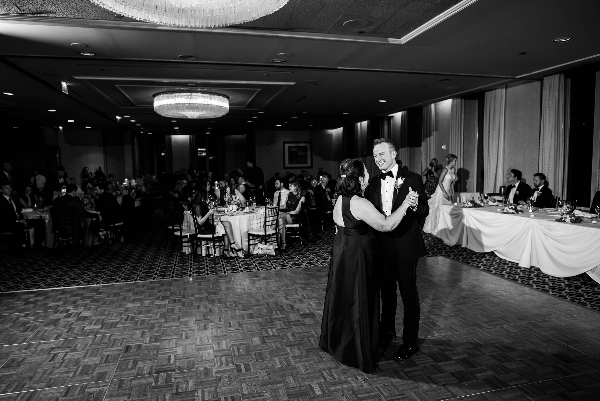 Mother and groom dance during their wedding reception at the Mid America Club in Chicago.