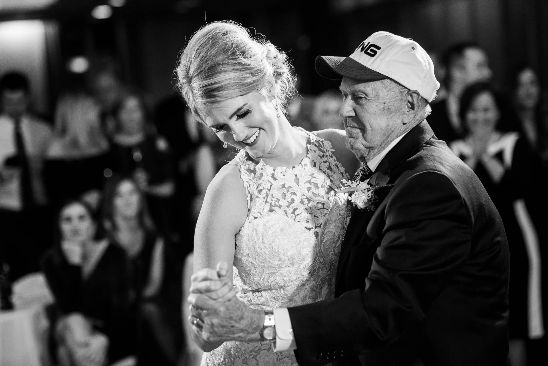 Bride and grandpa during a wedding reception at the Mid America Club in Chicago.