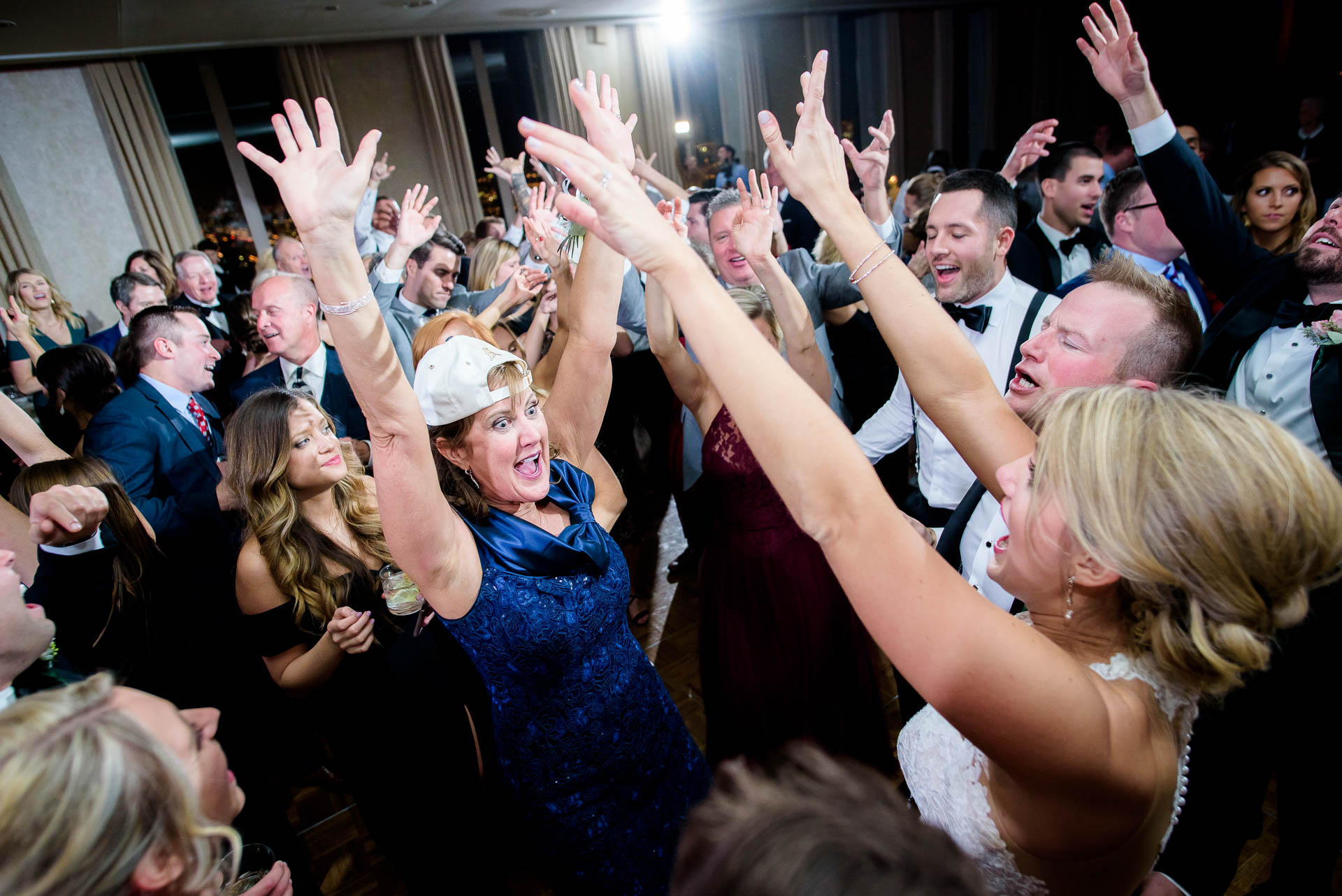 Packed dance floor during a wedding reception at the Mid America Club in Chicago.