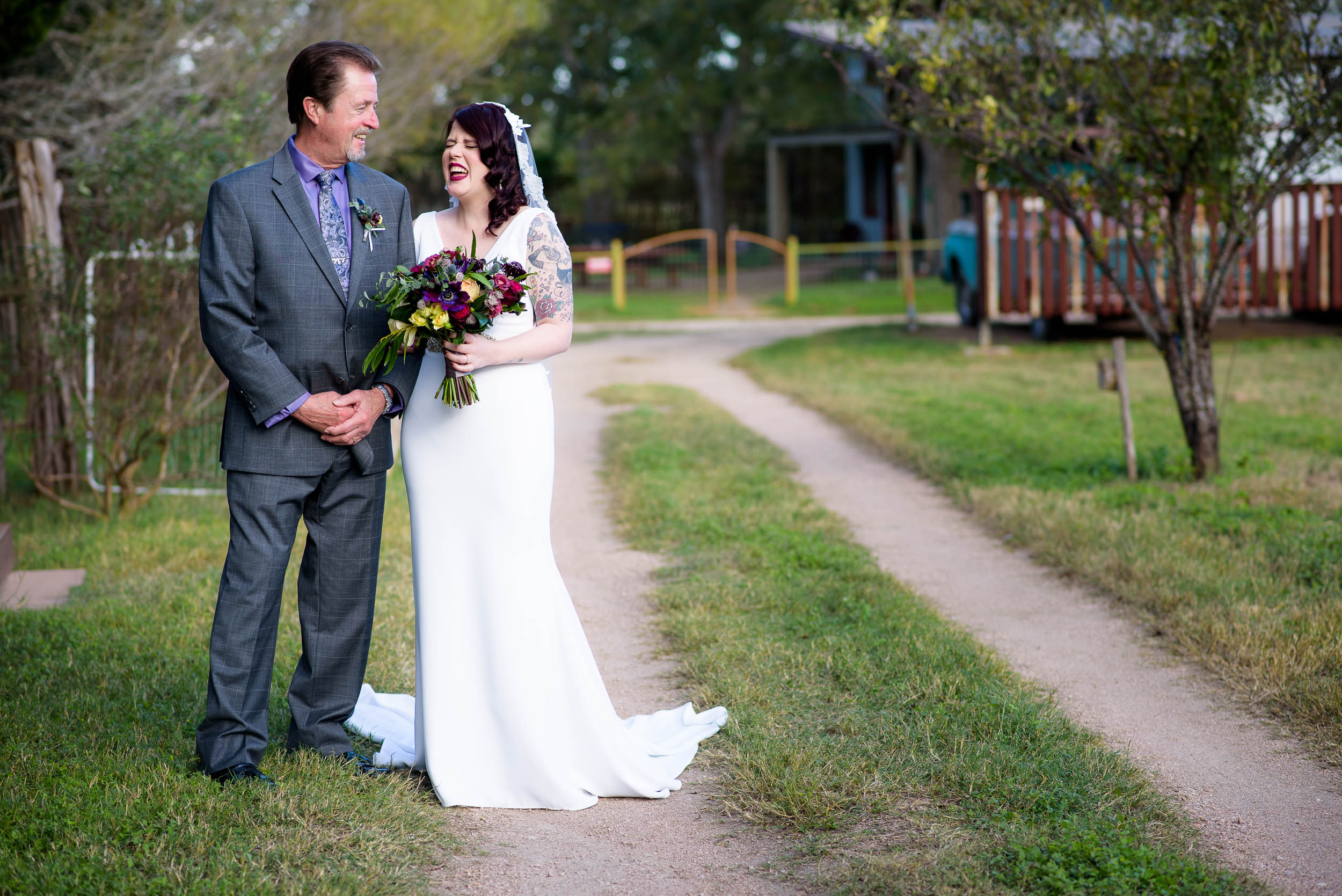 Funny moment before father and daughter during a Montesino Ranch wedding Austin, Texas.
