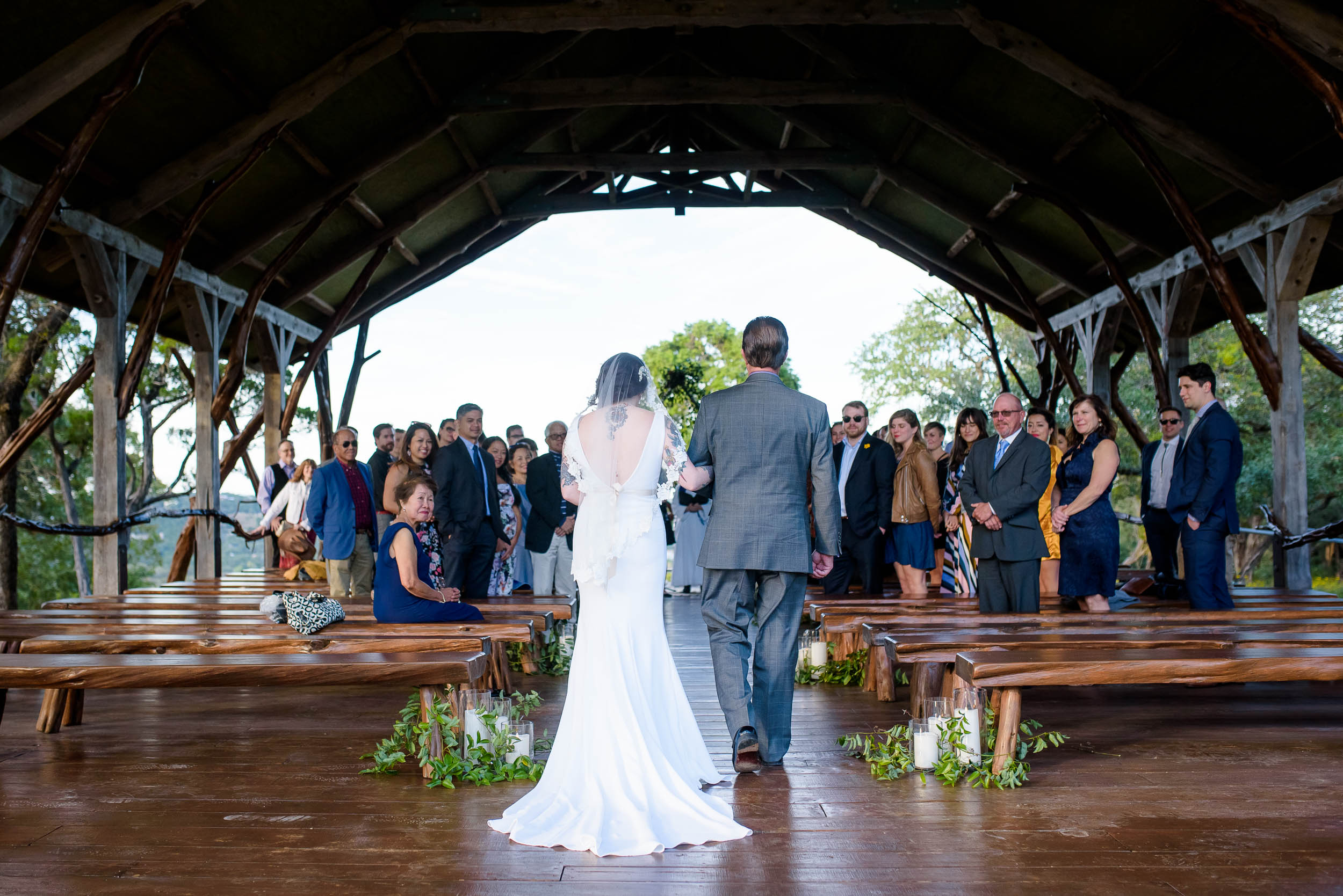 Father and bride walk down the aisle during a Montesino Ranch wedding Austin, Texas.