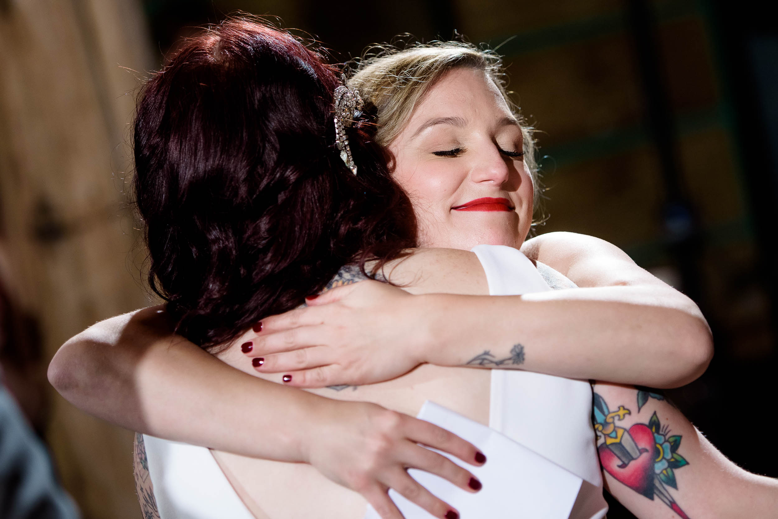 Bride and maid of honor hug during a Montesino Ranch wedding Austin, Texas.