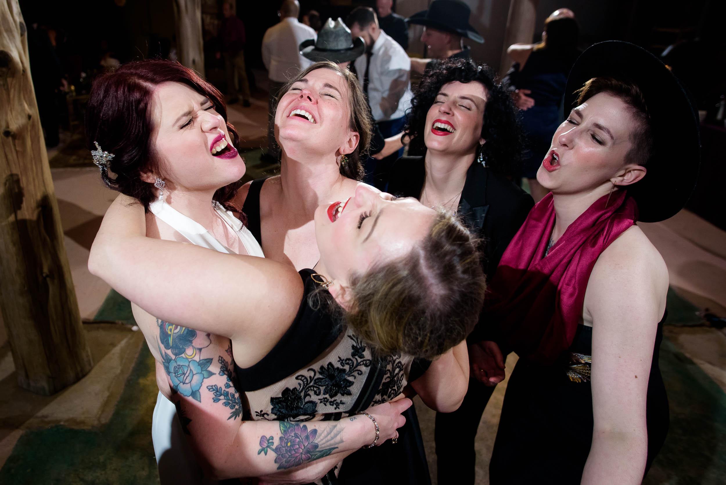 Bridesmaids dance during a Montesino Ranch wedding Austin, Texas.