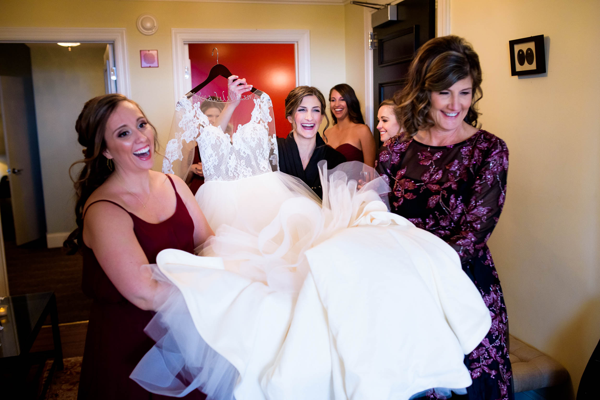 Bride and bridesmaid carry the dress during a Blackstone Chicago wedding.