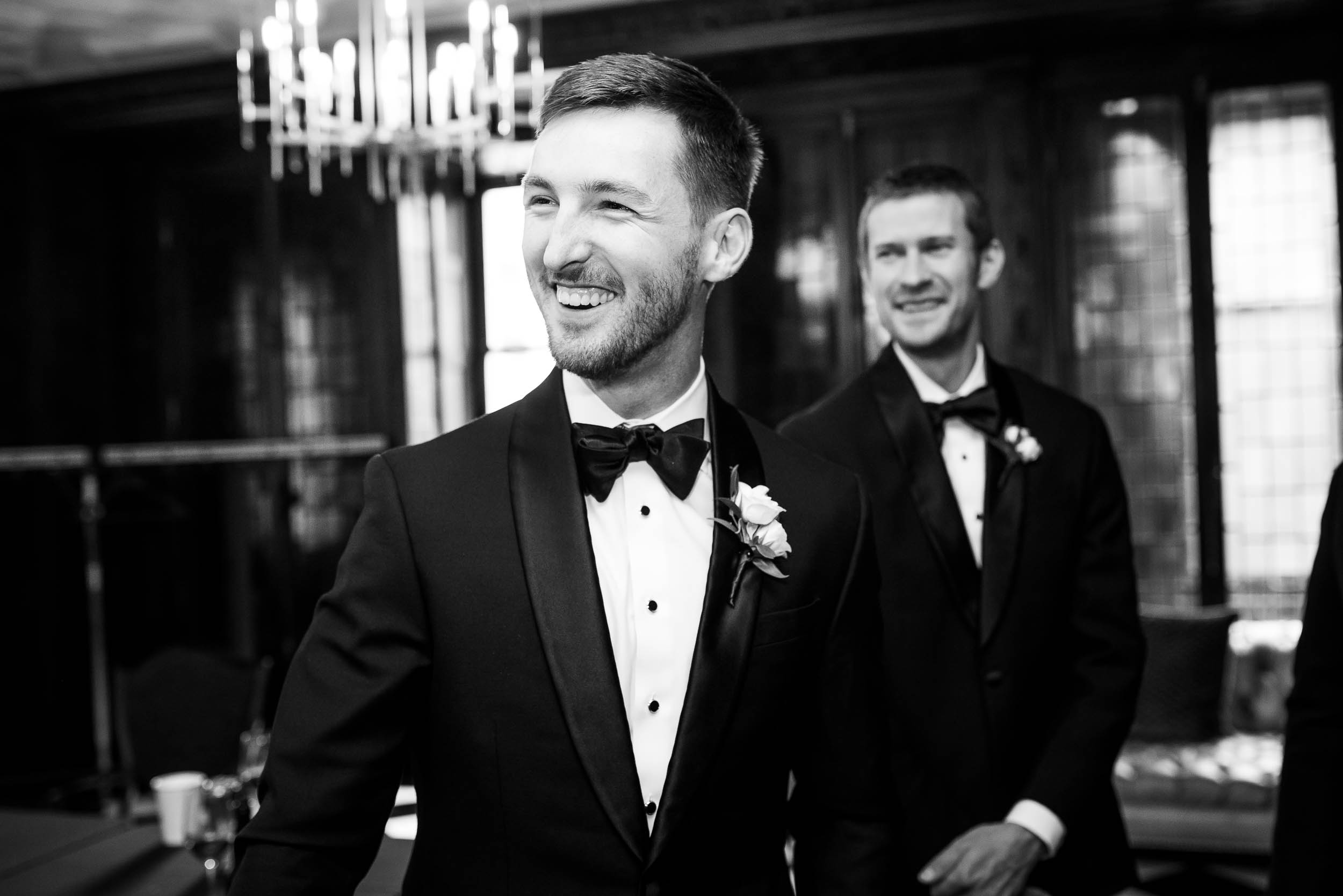 Groom shares a laugh with his friends during a Blackstone Chicago wedding.