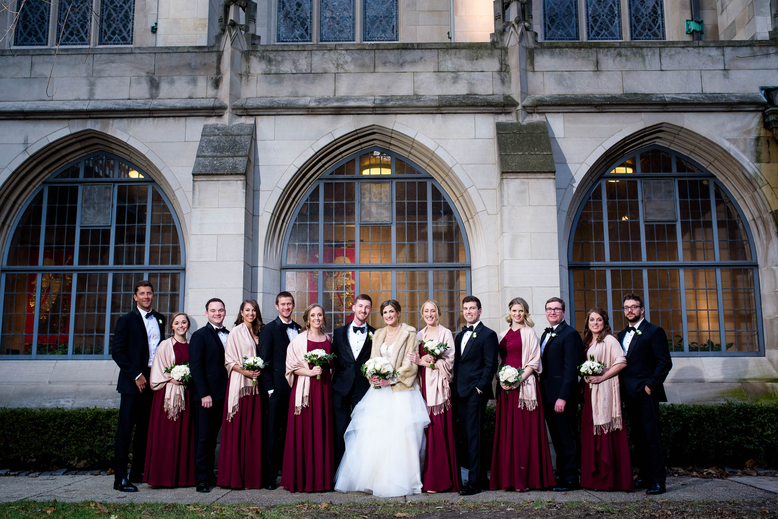 Wedding party courtyard portrait during a Fourth Presbyterian Church wedding.