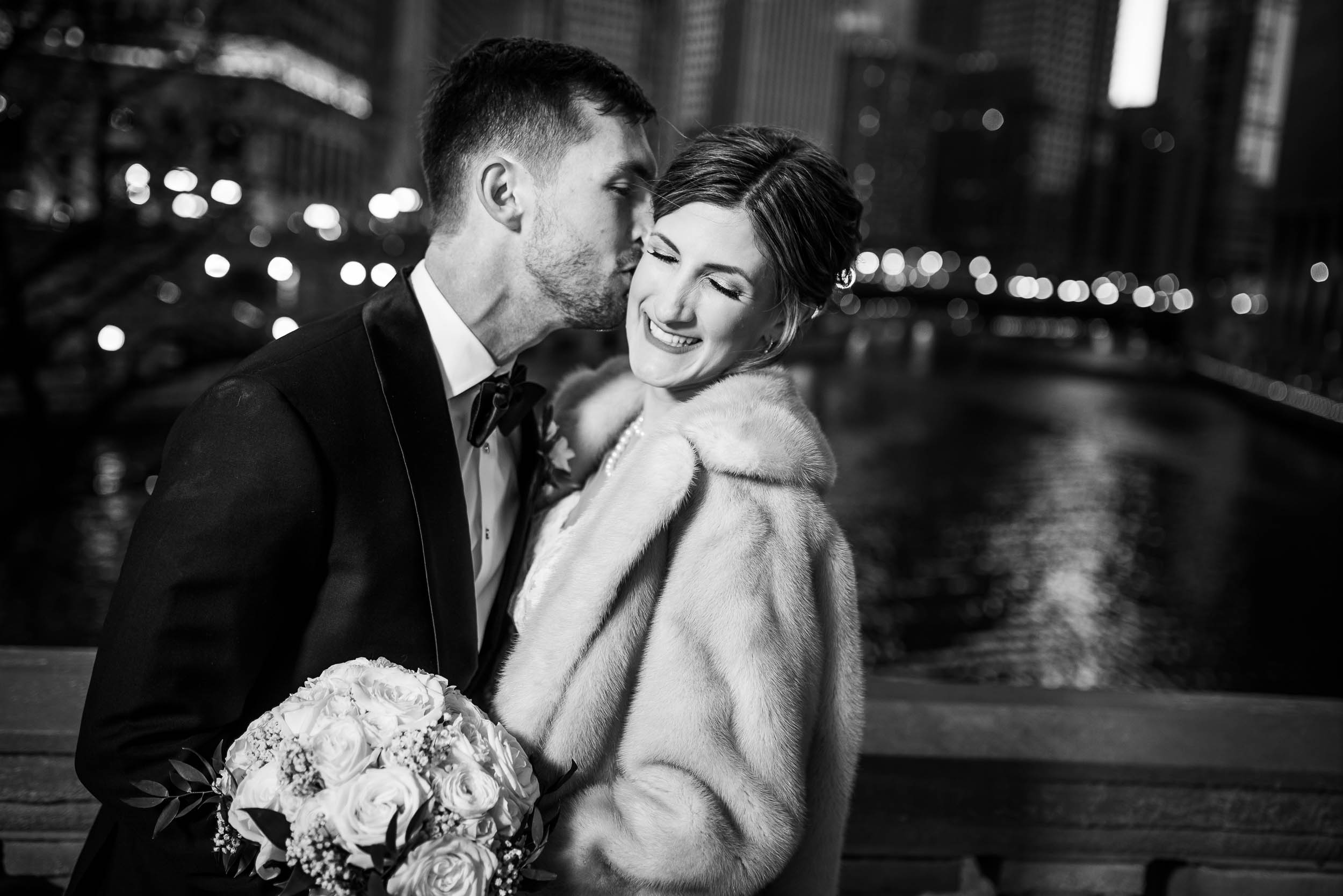 Black and white portrait of the couple overlooking the Chicago River during a Blackstone Chicago wedding.