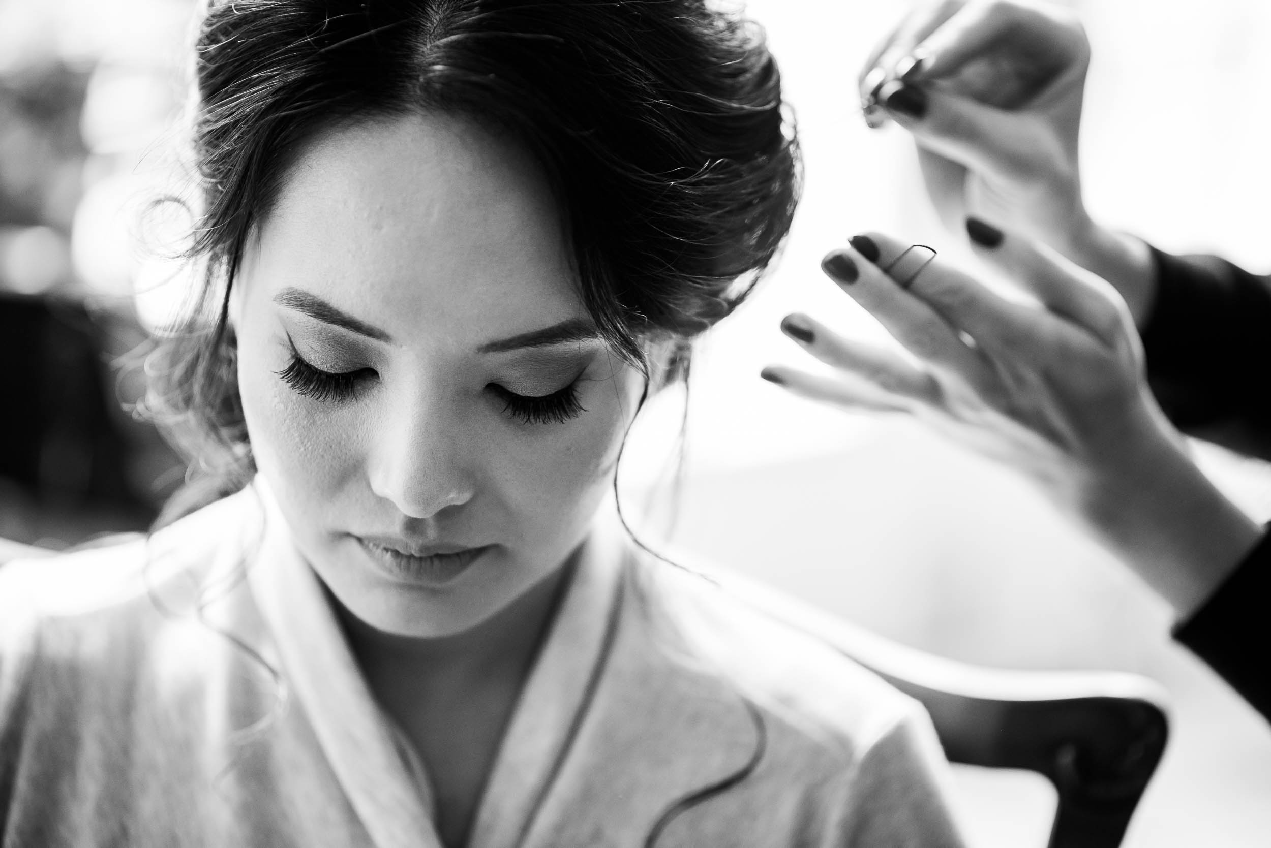 Bride getting ready before her Loft on Lake Chicago wedding.