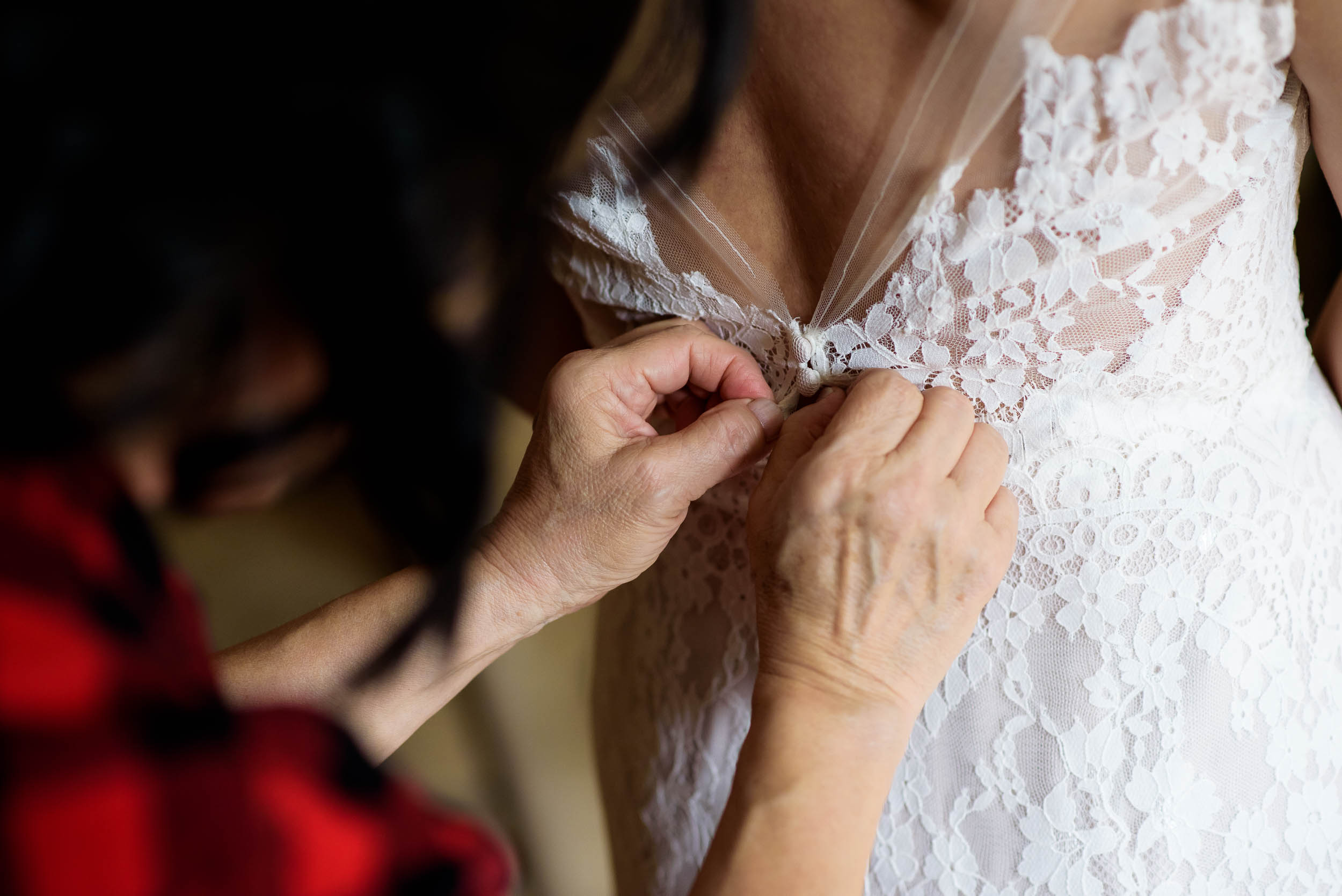 Mom helping the bride get ready before her Loft on Lake Chicago wedding.