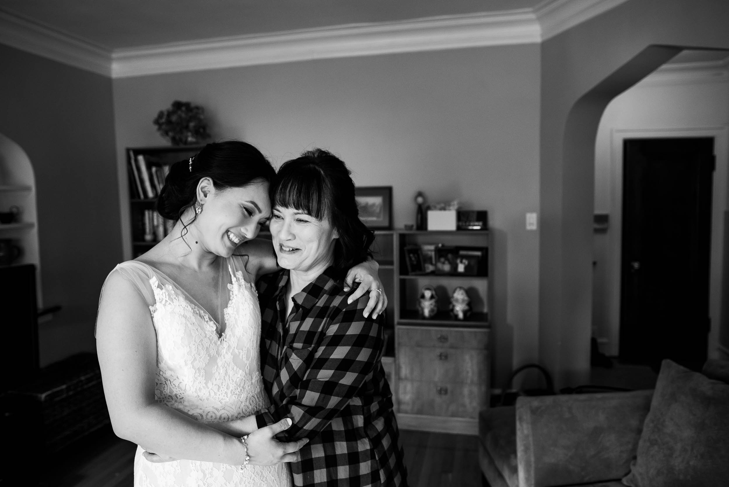 Mother and bride hug before a Loft on Lake Chicago wedding.