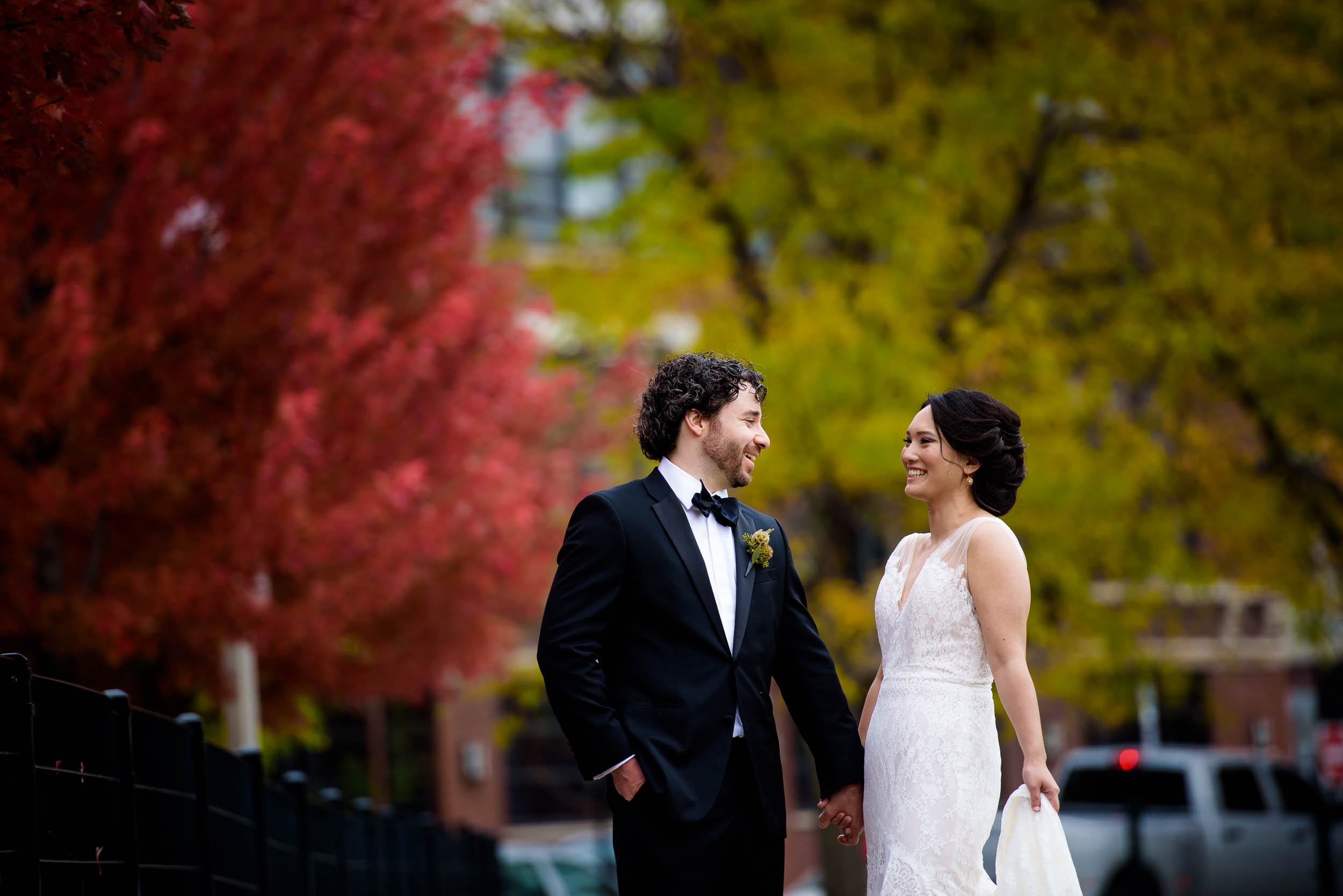 Bride and groom laugh together during their wedding photo session at Mary Bartelme Park Chicago.