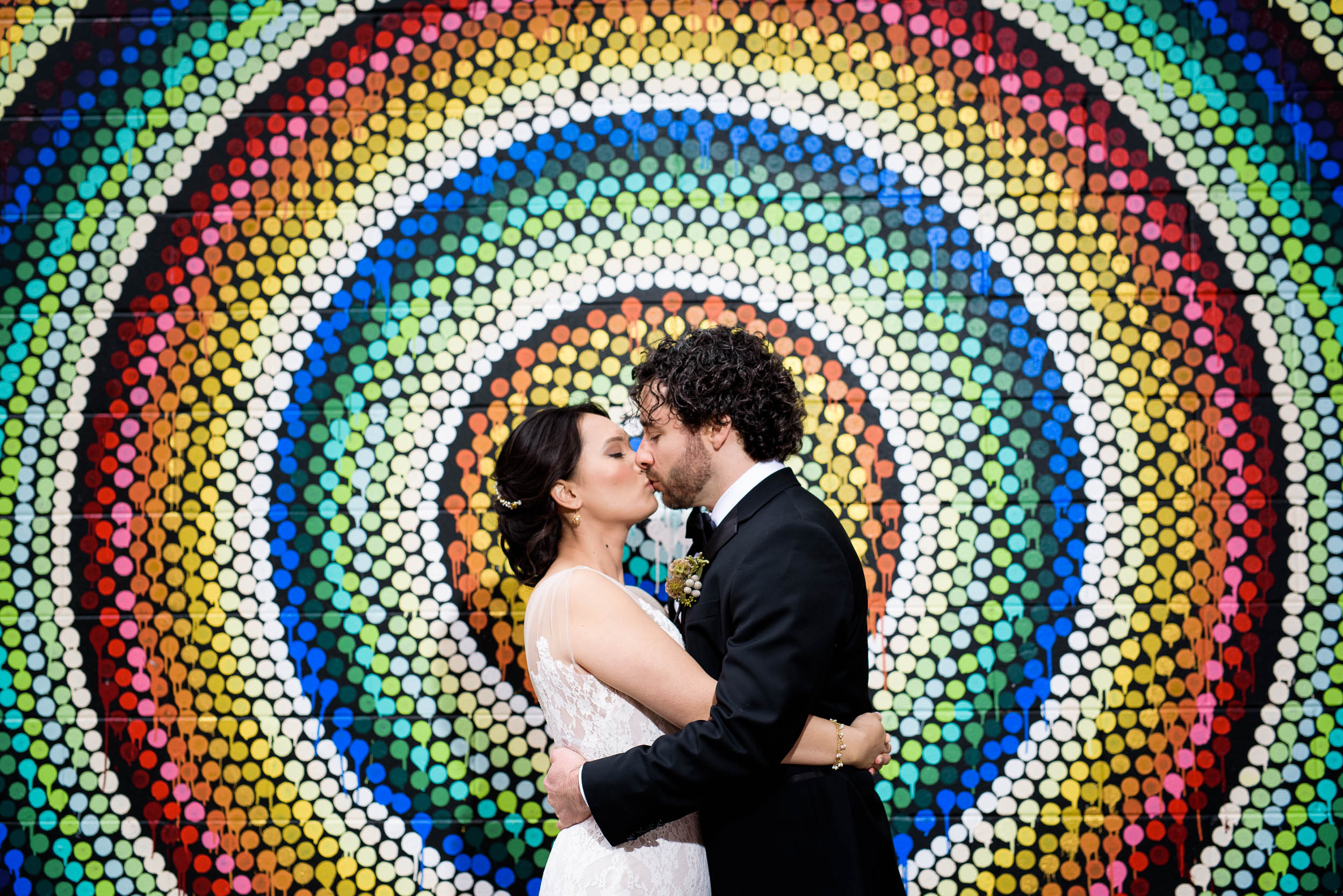 Creative photo of bride and groom with street art before their Loft on Lake Chicago wedding.