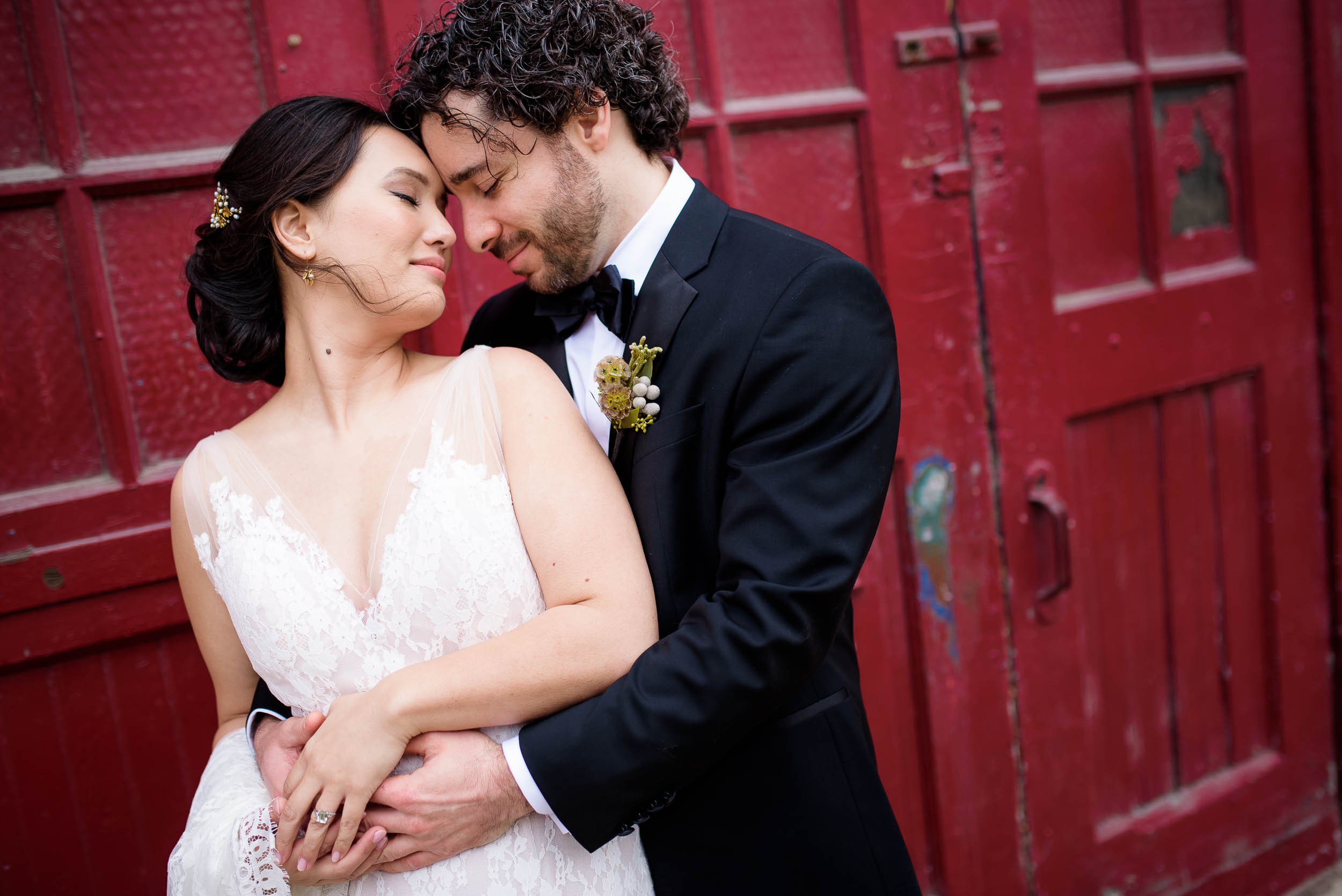 Intimate portrait of the couple outside the Mars Gallery before a Loft on Lake Chicago wedding.