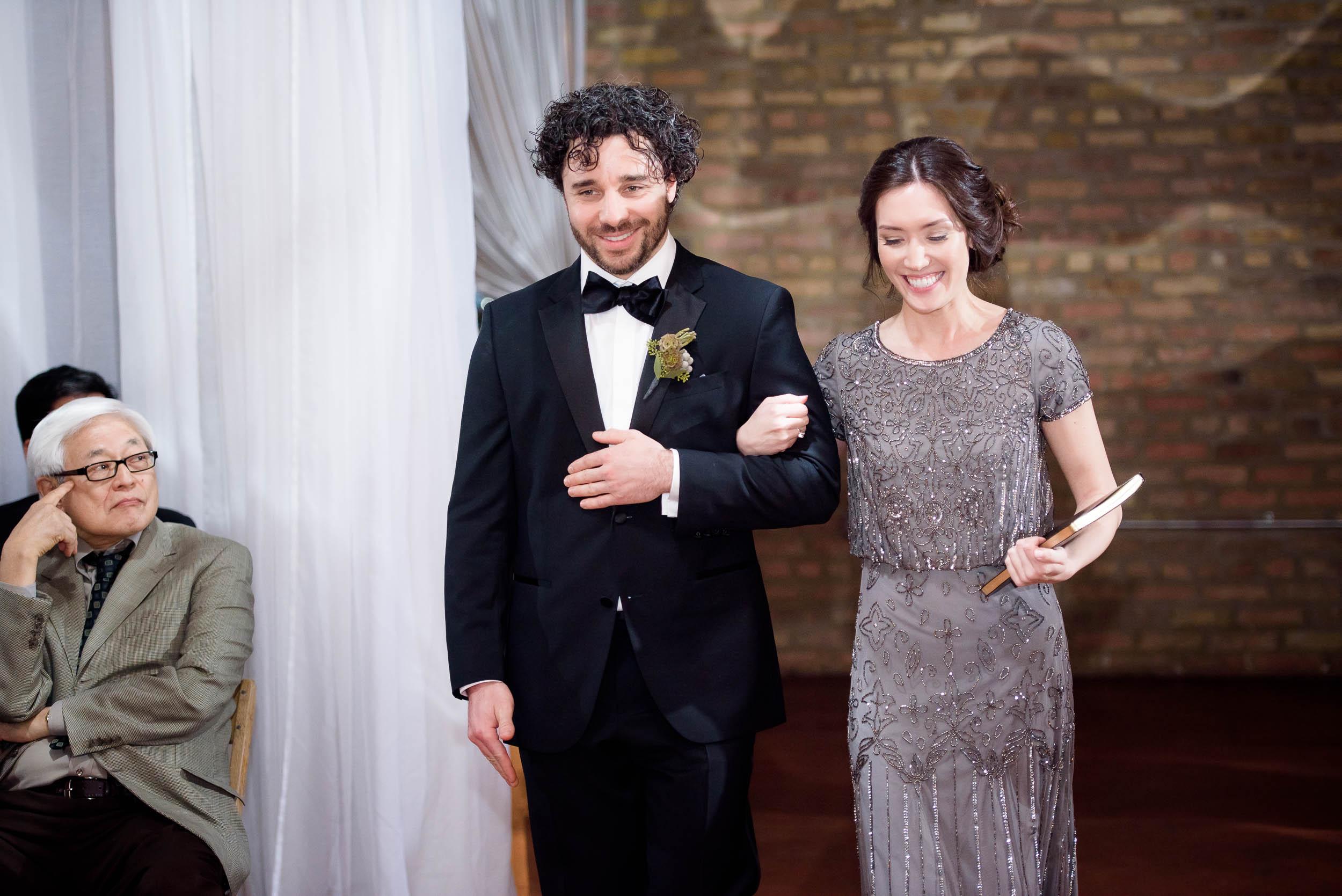 Groom walks down the aisle during his Loft on Lake Chicago wedding.