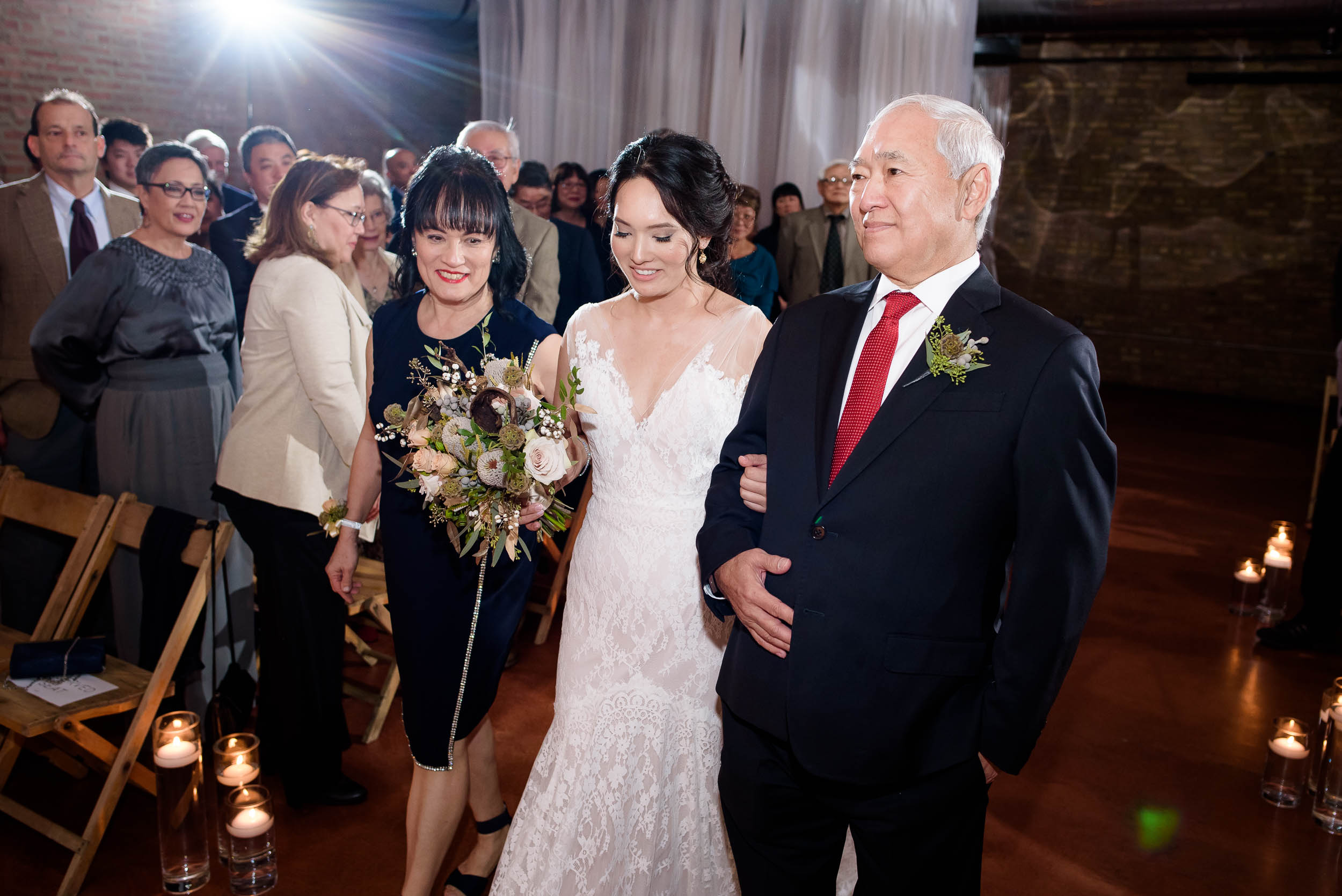 Bride and parents walk down the aisle during her Loft on Lake Chicago wedding.