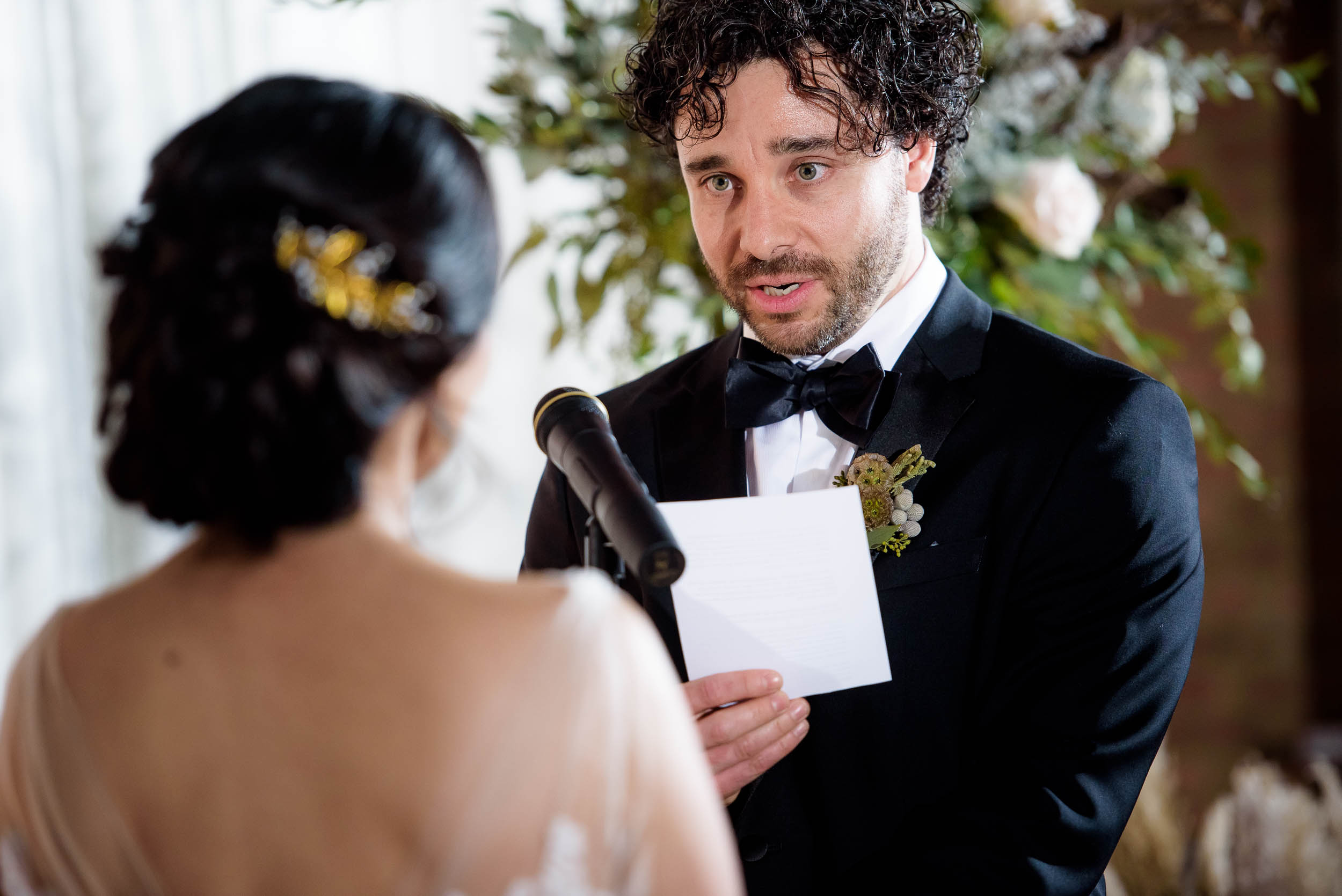 Groom reads vows during his Loft on Lake Chicago wedding.