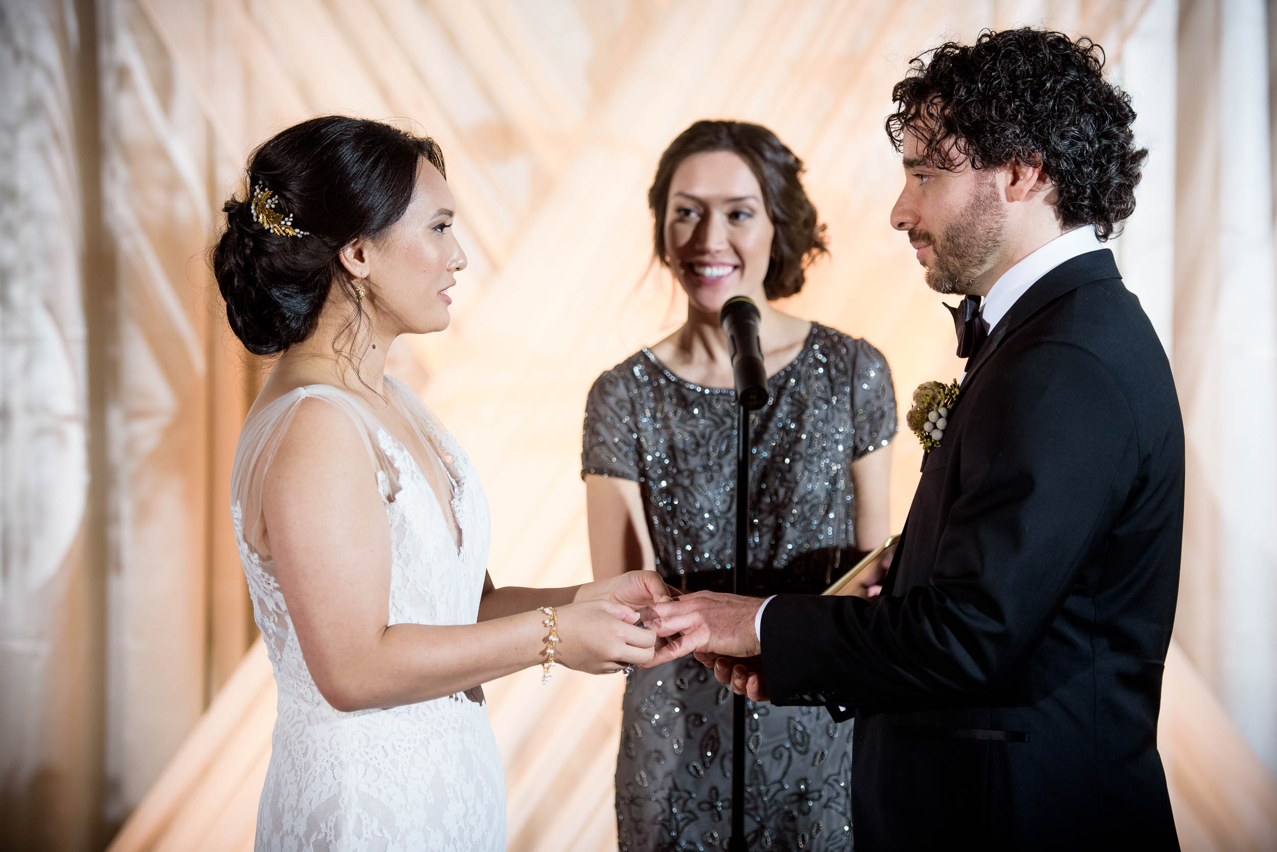 Exchange of rings during a Loft on Lake Chicago wedding.