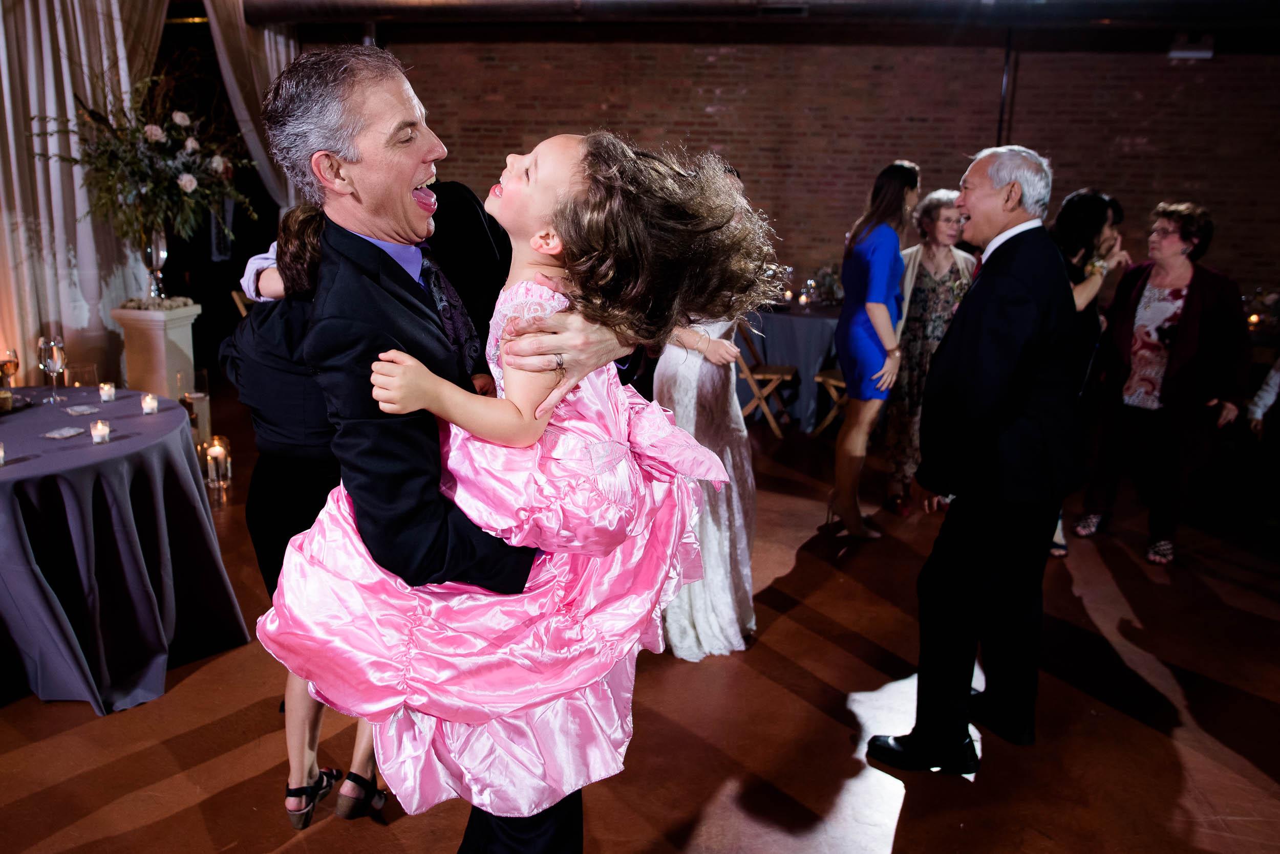 Flower girl on the dance floor during a Loft on Lake Chicago wedding.
