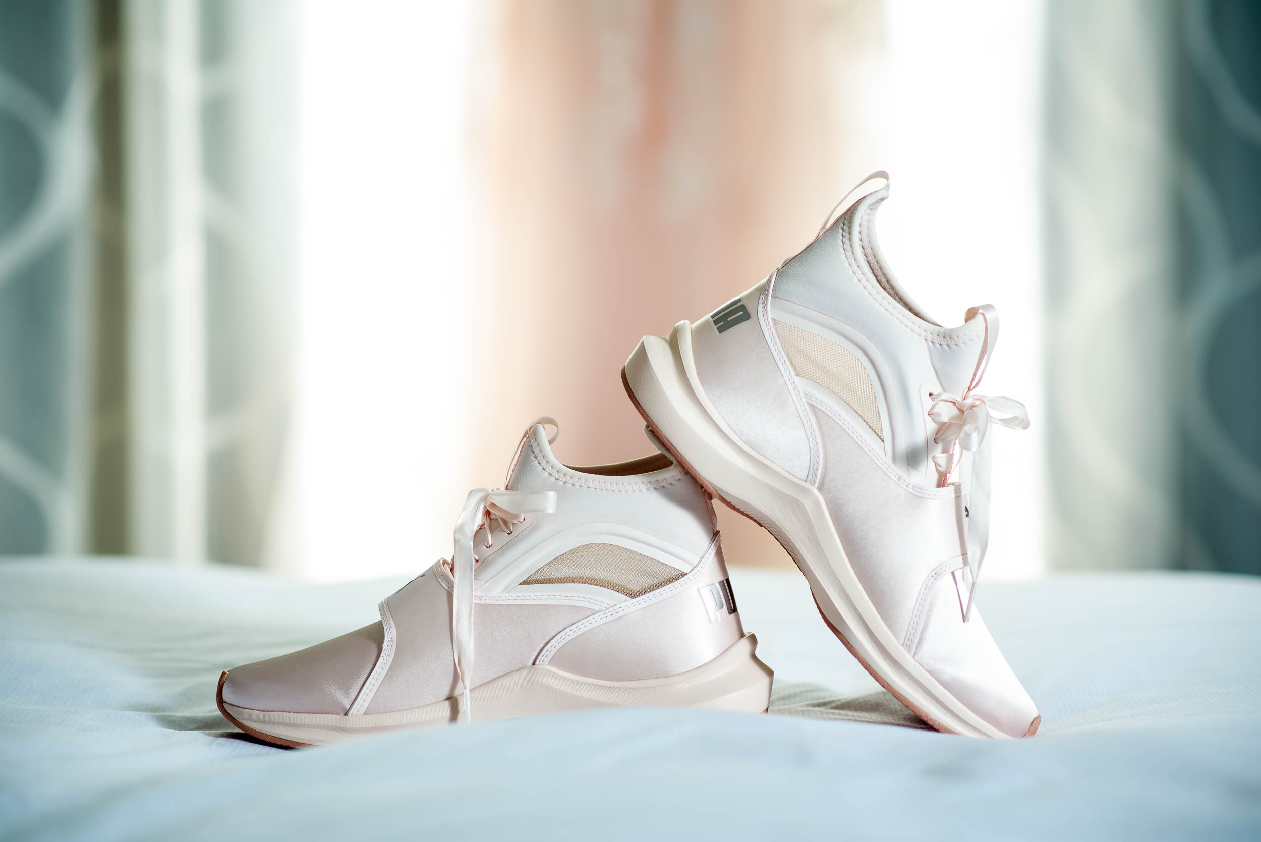 Bride's Puma wedding day shoes during an Independence Grove Chicago wedding.