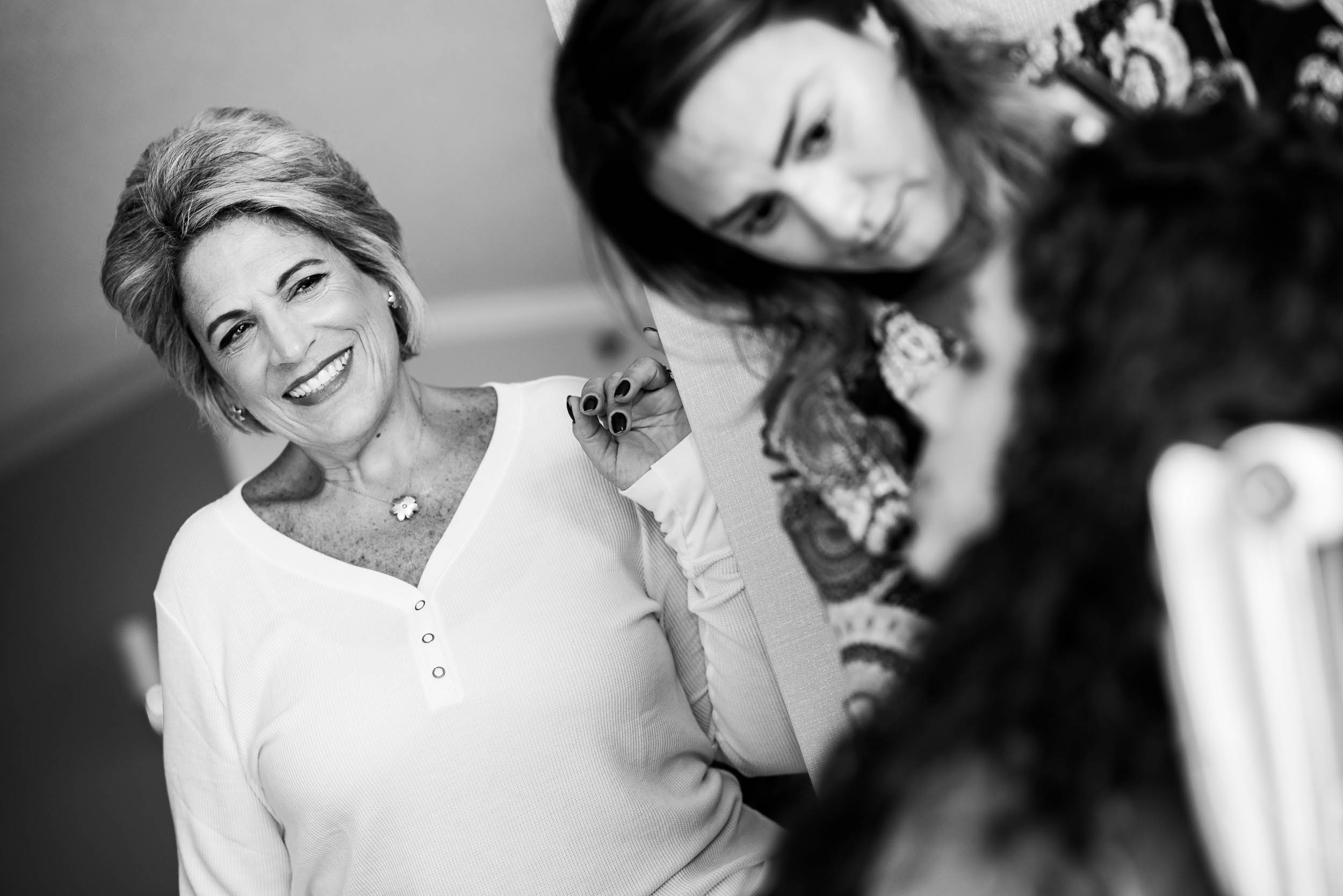 Mother of the bride looks to her daughter during an Independence Grove Chicago wedding.