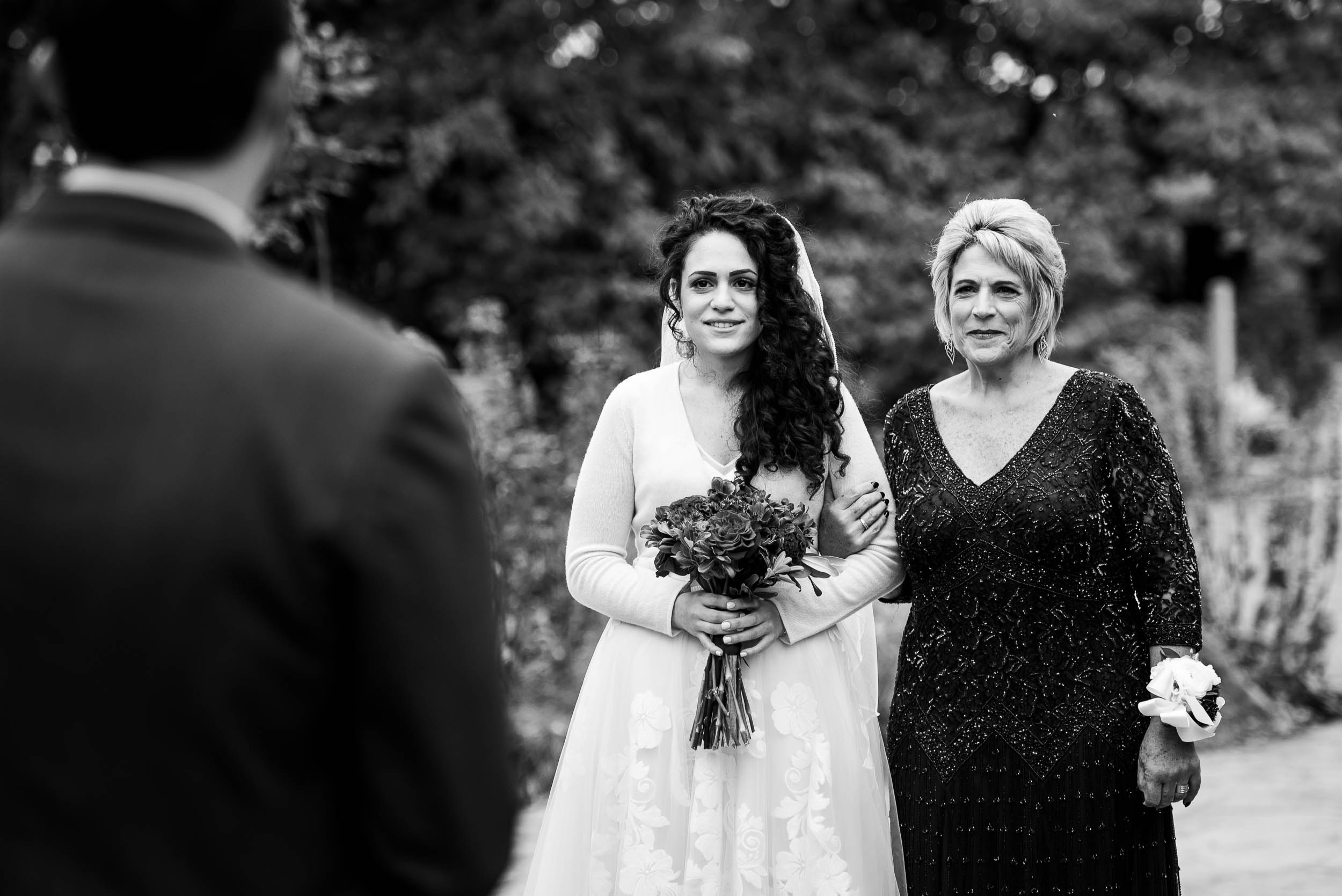 Bride and groom meet at Jewish ceremony during an Independence Grove Chicago wedding.