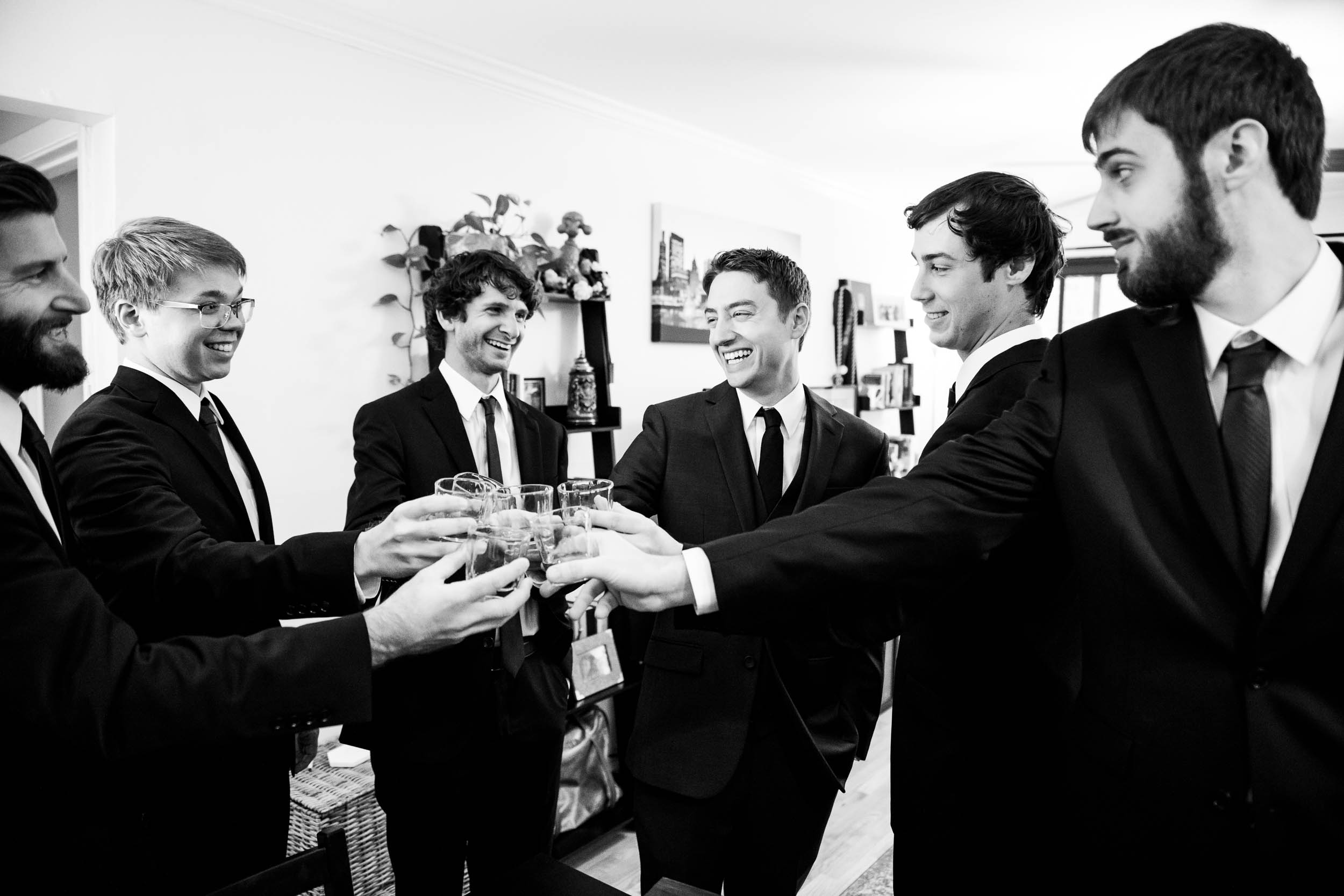 Groomsmen toast during a Newberry Library Chicago wedding.