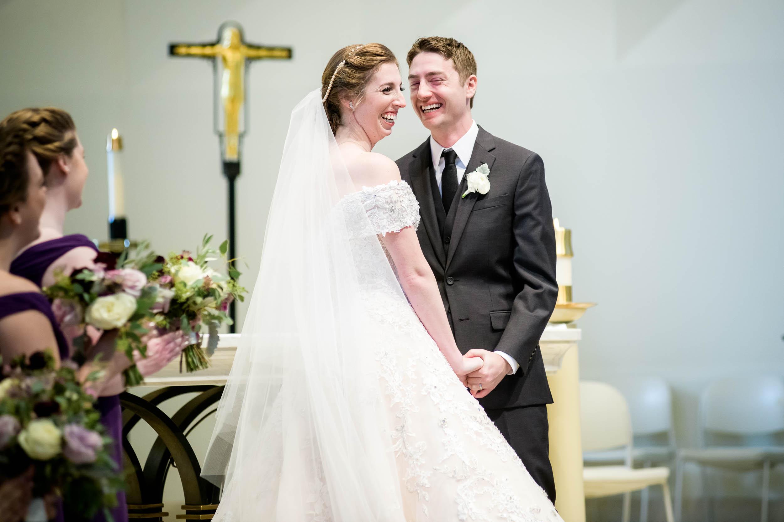 Bride and groom share a laugh during a wedding ceremony at Madonna Della Strada.