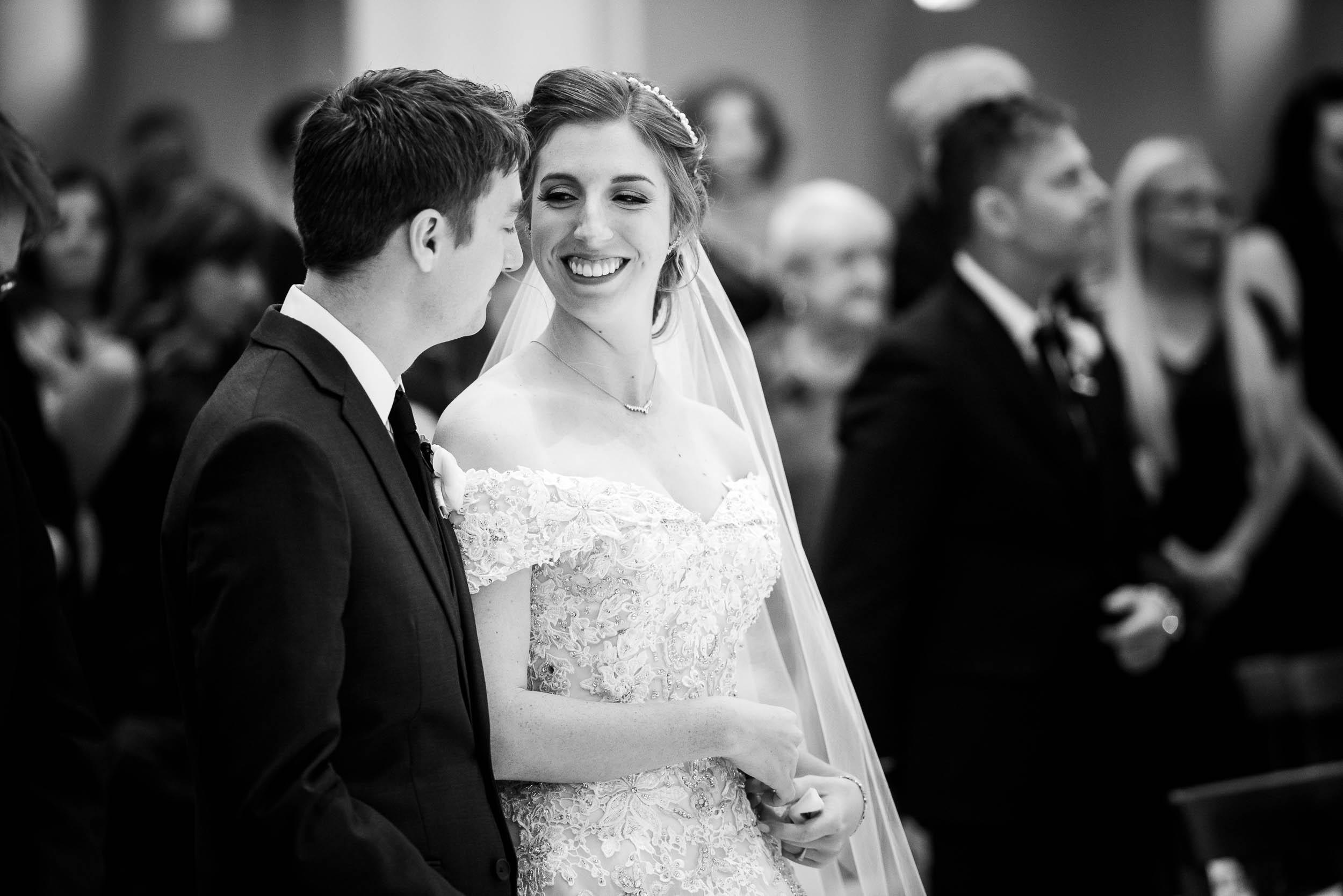 Brides gazes toward her groom during a wedding ceremony at Madonna Della Strada.