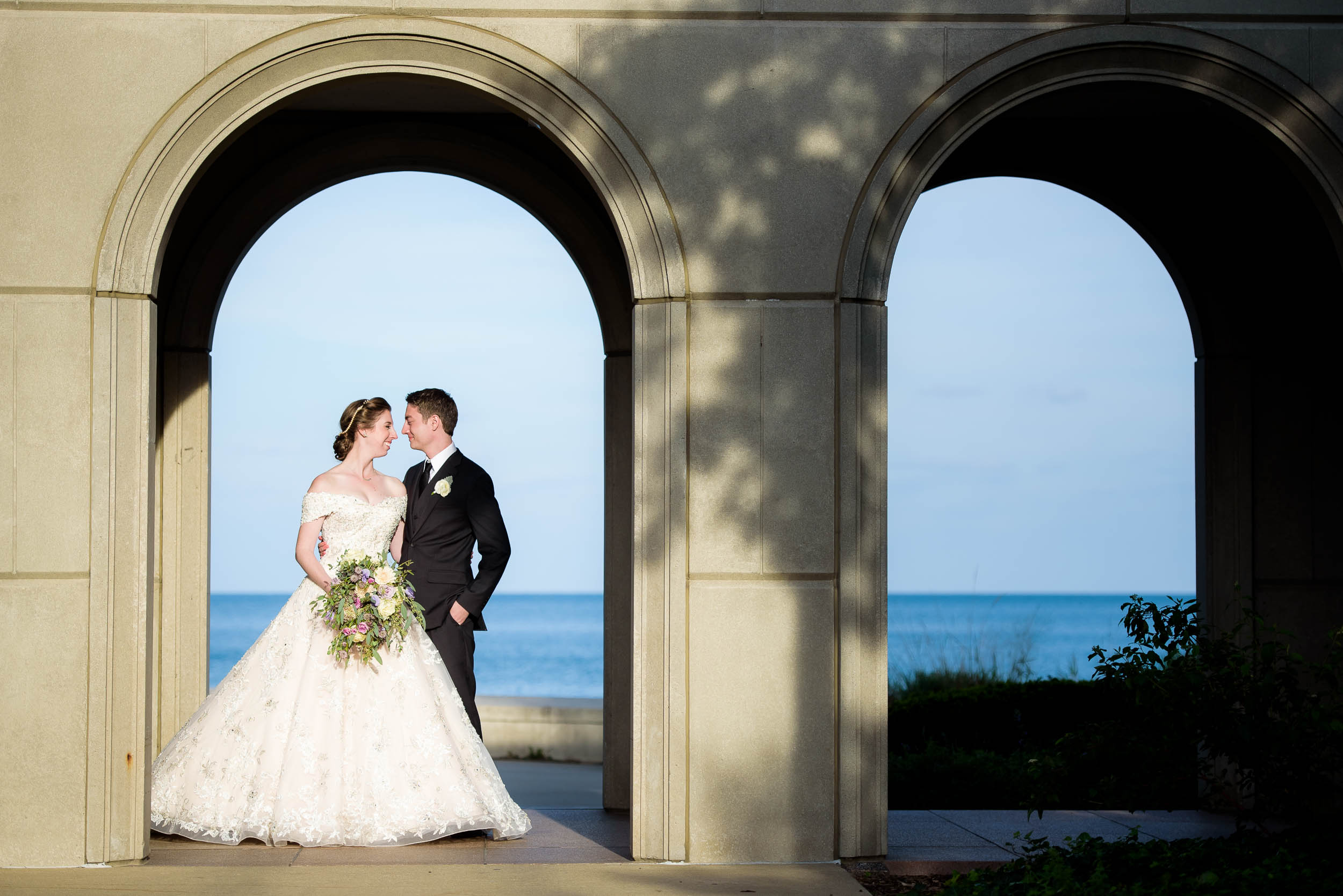 Wedding day portrait of the bride and groom on Loyola's Campus.