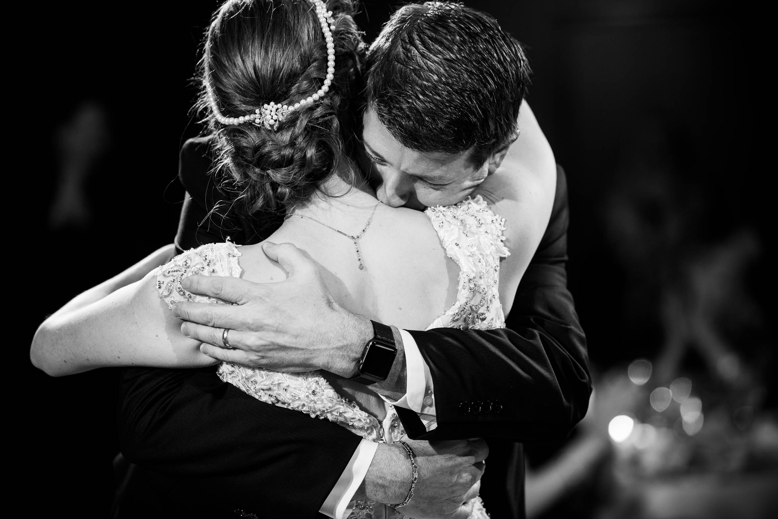 Father and daughter hug during a Newberry Library Chicago wedding.