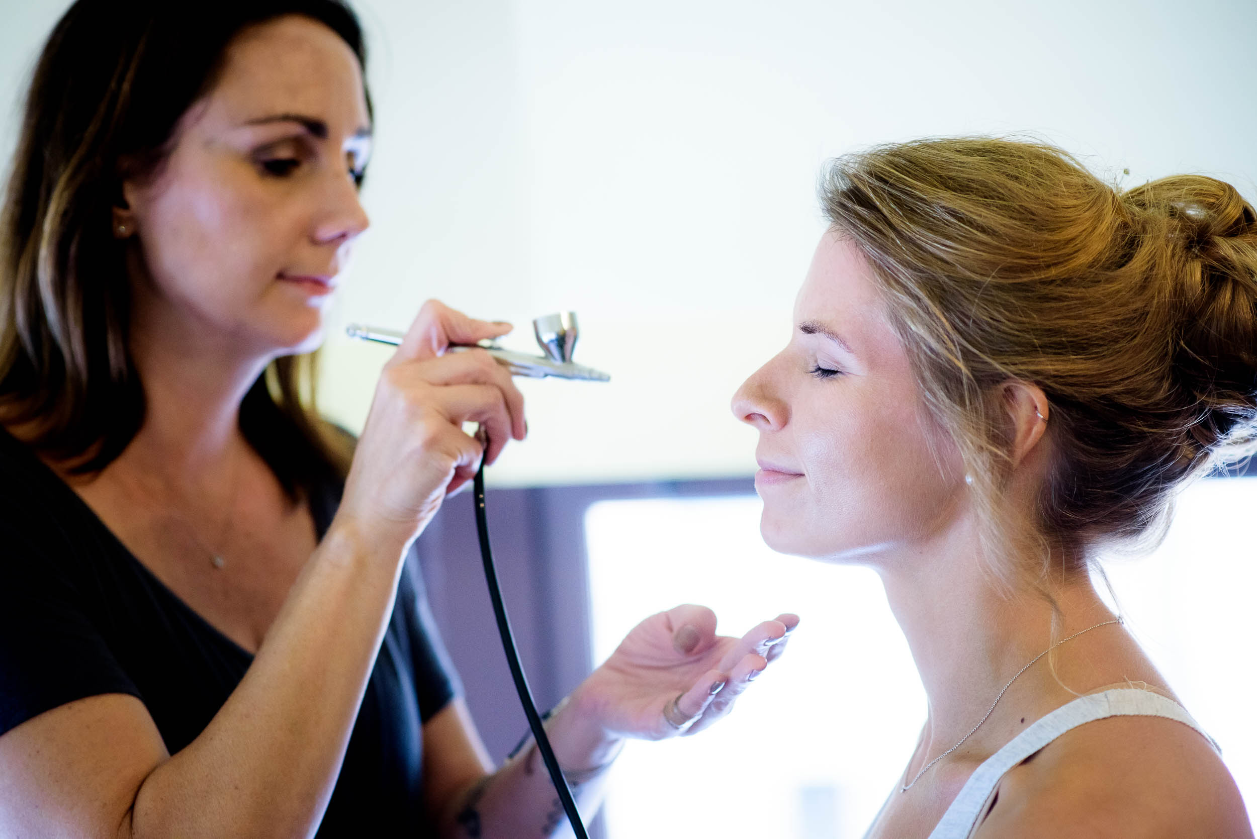 Bride getting makeup done during her Glessner House Chicago wedding.