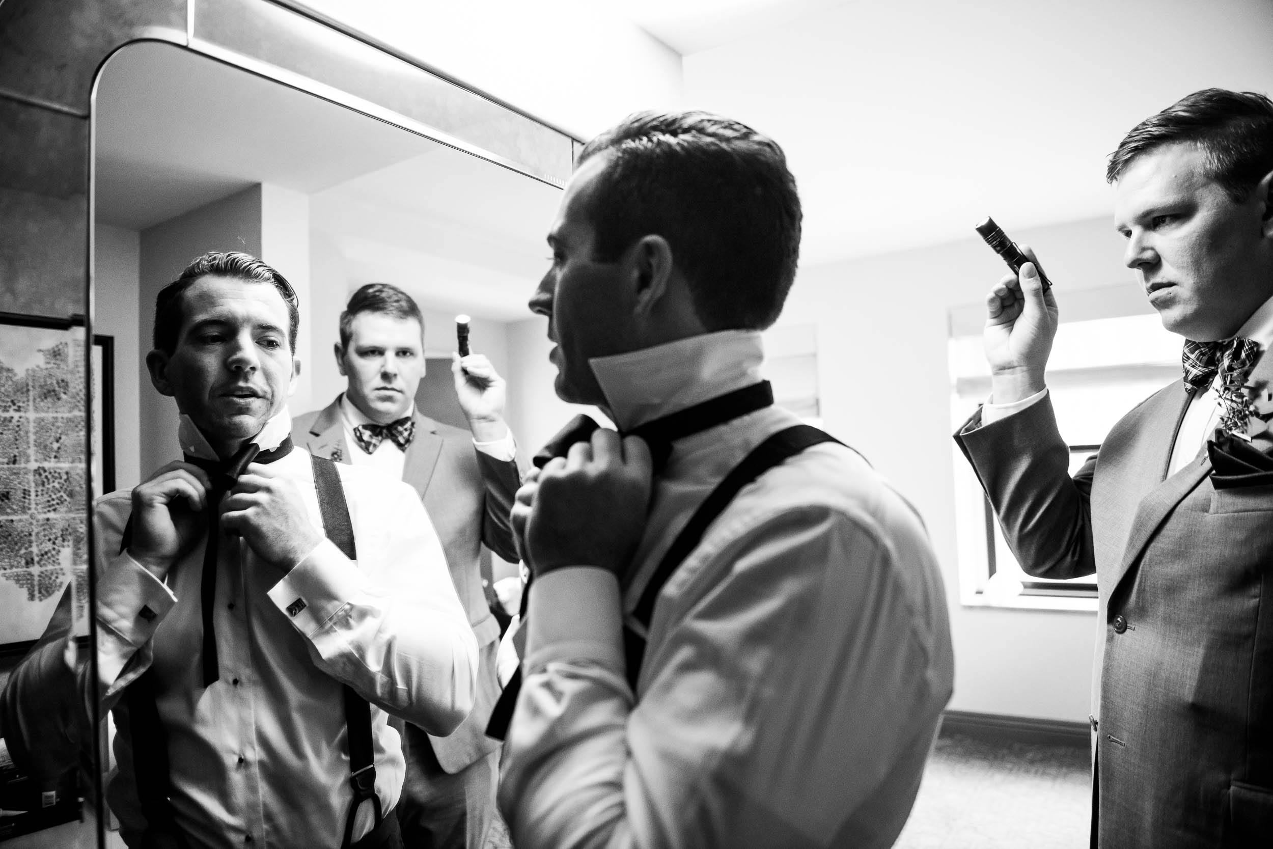 Groom and groomsmen getting ready during a Glessner House Chicago wedding.