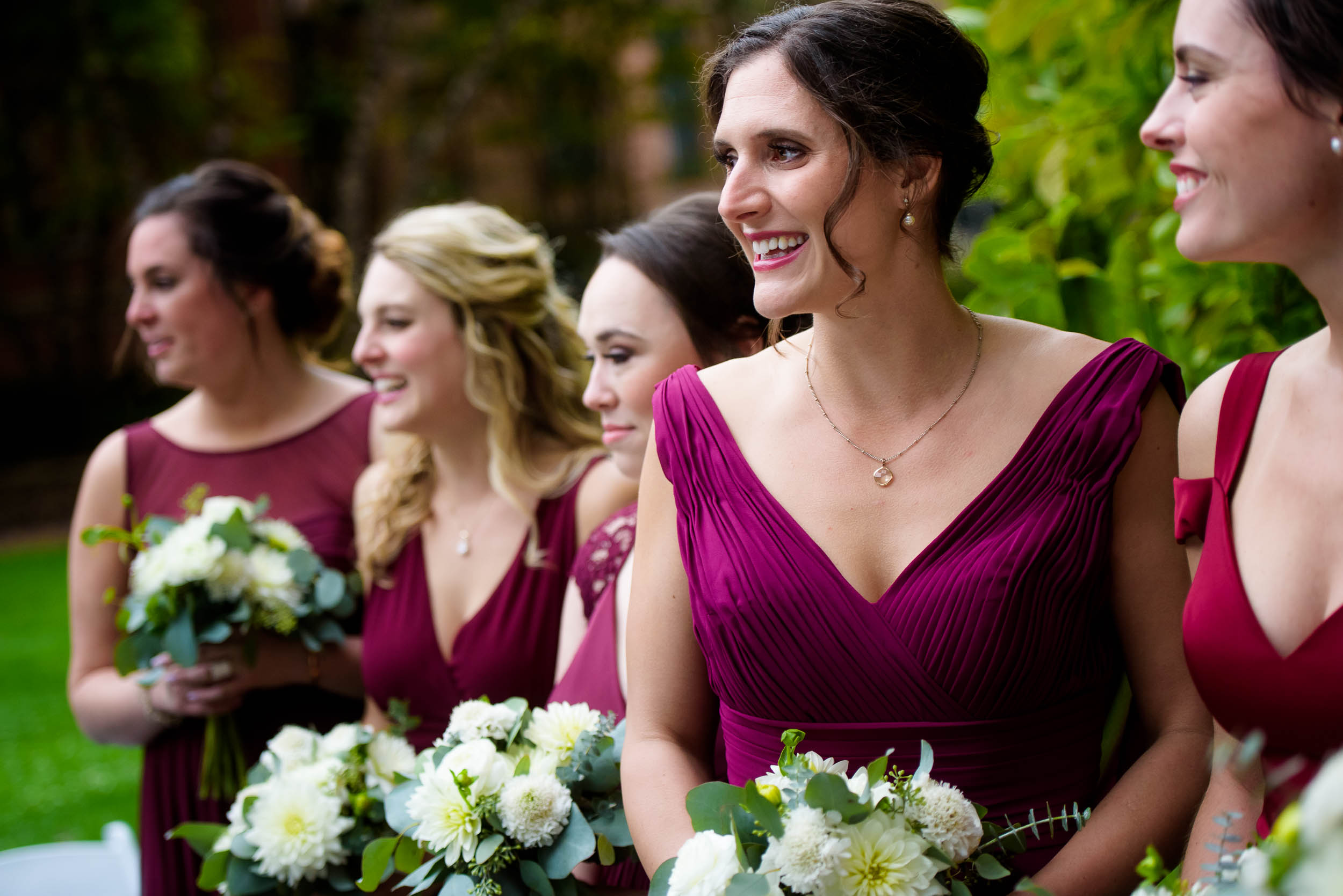 Bridesmaid watch the bride come down the aisle during a Glessner House Chicago wedding.