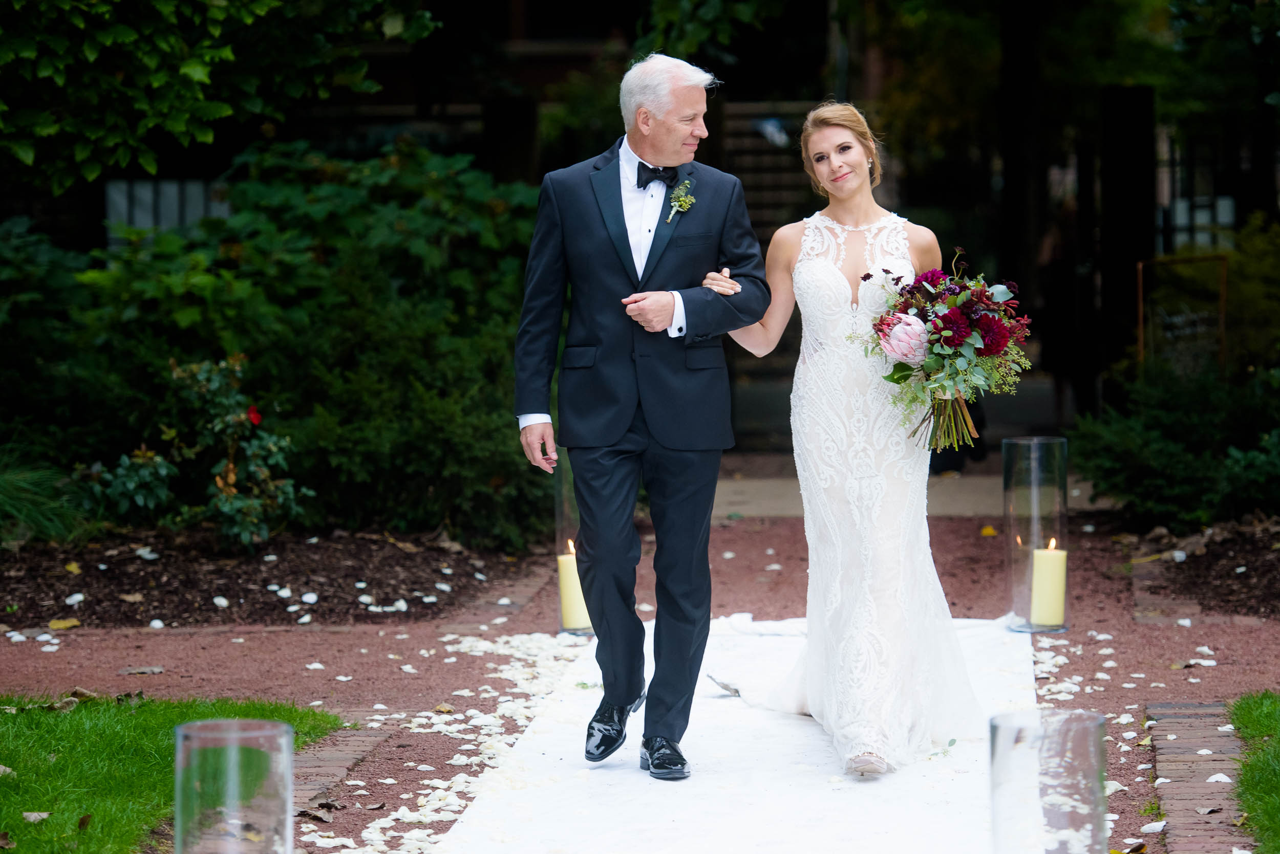 Father and bride walk down the aisle during a Glessner House Chicago wedding.