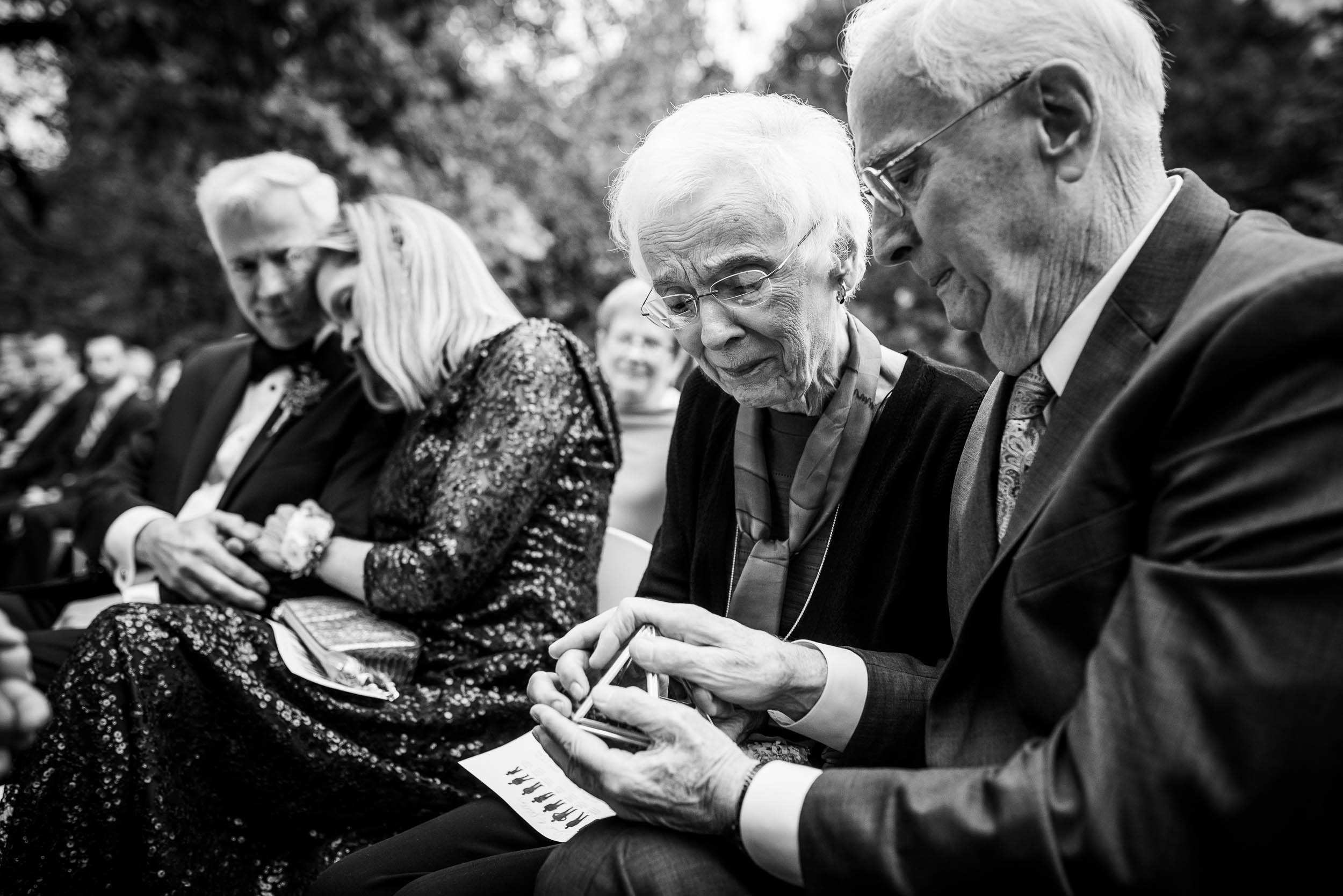 Grandparents partake in a ring warming ceremony during a Glessner House Chicago wedding.