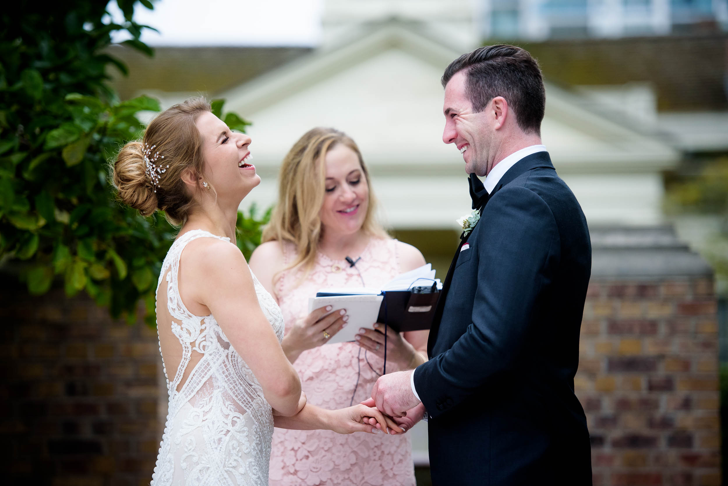 Bride and groom share a laugh during a Glessner House Chicago wedding ceremony.