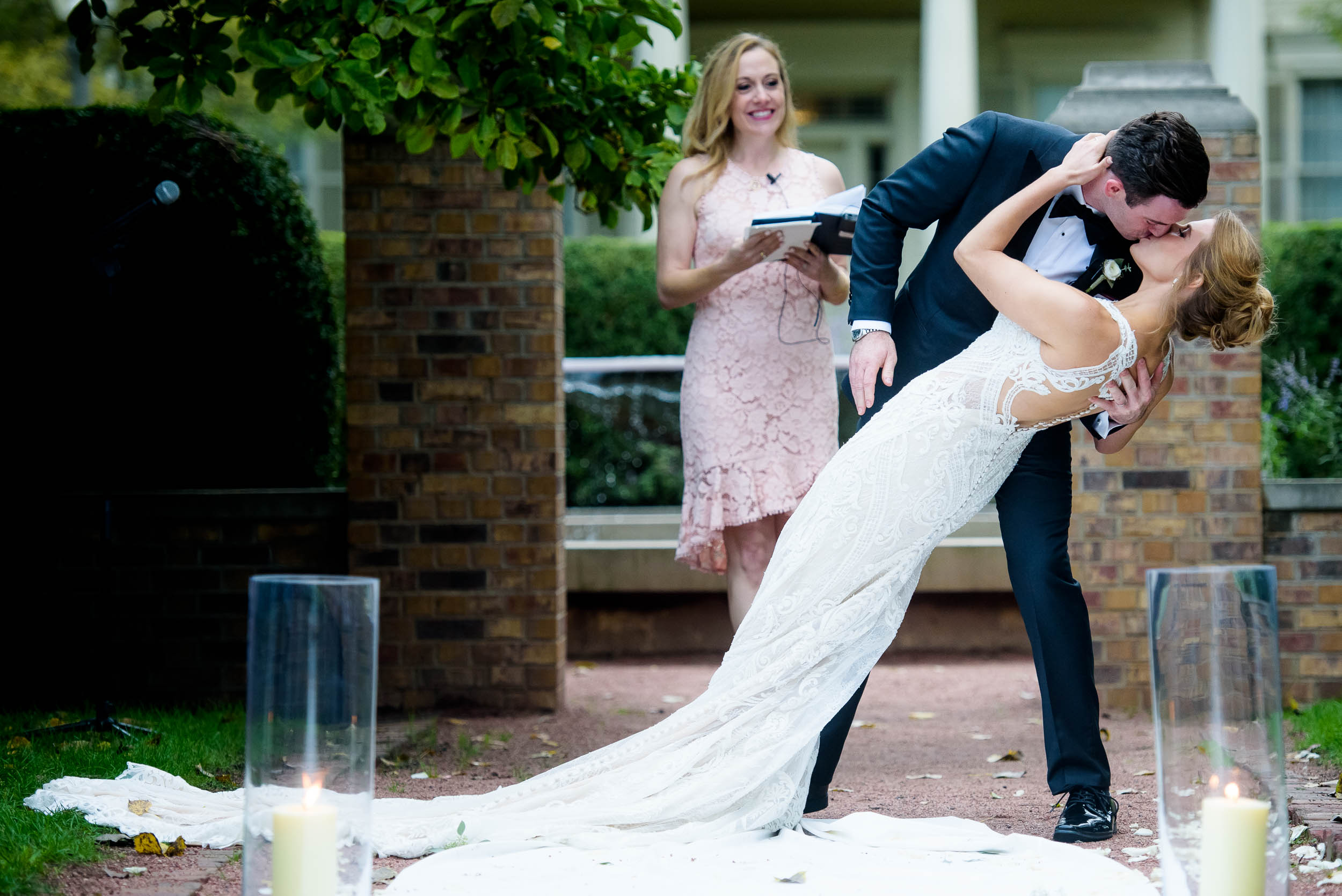 Groom dips the bride during a Glessner House Chicago wedding ceremony.